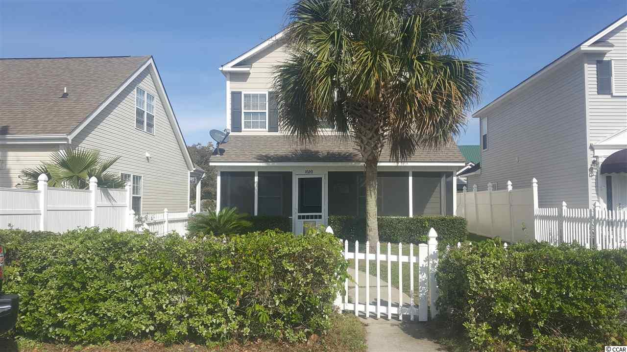Great Location!! Beautiful well maintained 3 bedroom/3 bath home located just blocks to the beach. This property features two fireplaces (upstairs and downstairs), first floor bedroom and bath, screened in porch and fenced in yard. Close to dining, shopping, golf, boating, fishing, putt putt and lot of fun and local entertainment