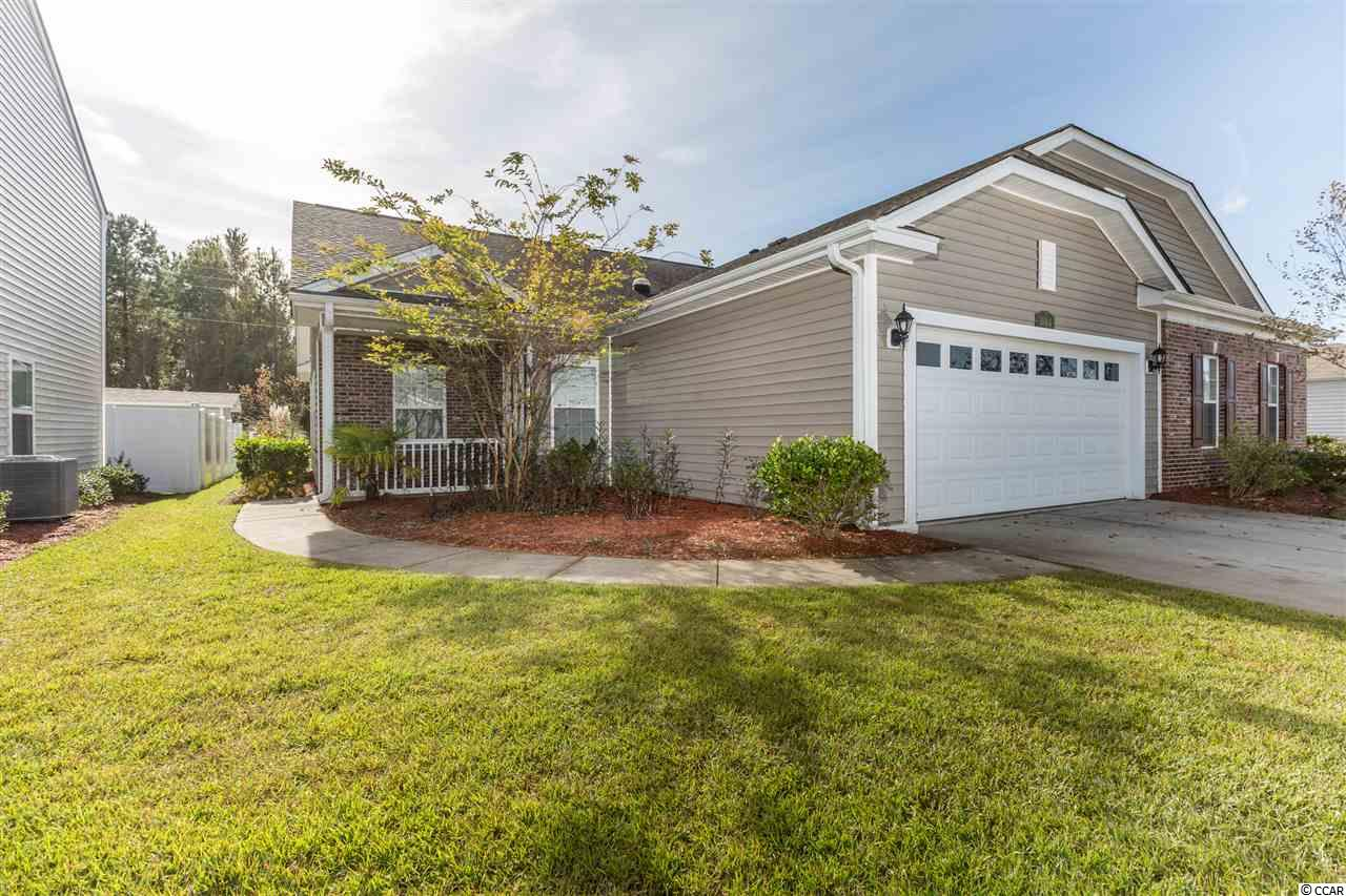 This open floor plan paired ranch located in the desirable Midtown Village boasts a brick front, 2 car garage, spacious master bedroom, a Carolina room, screened in porch, back patio and more. Community amenities include a pool, community clubhouse, lawn maintenance, irrigation, basic cable, sidewalks, streetlights and more! Located minutes from downtown Conway, shopping, a short drive to beaches and the rest of what the Grand Strand has to offer. You must see this home to appreciate the spacious layout and great neighborhood.