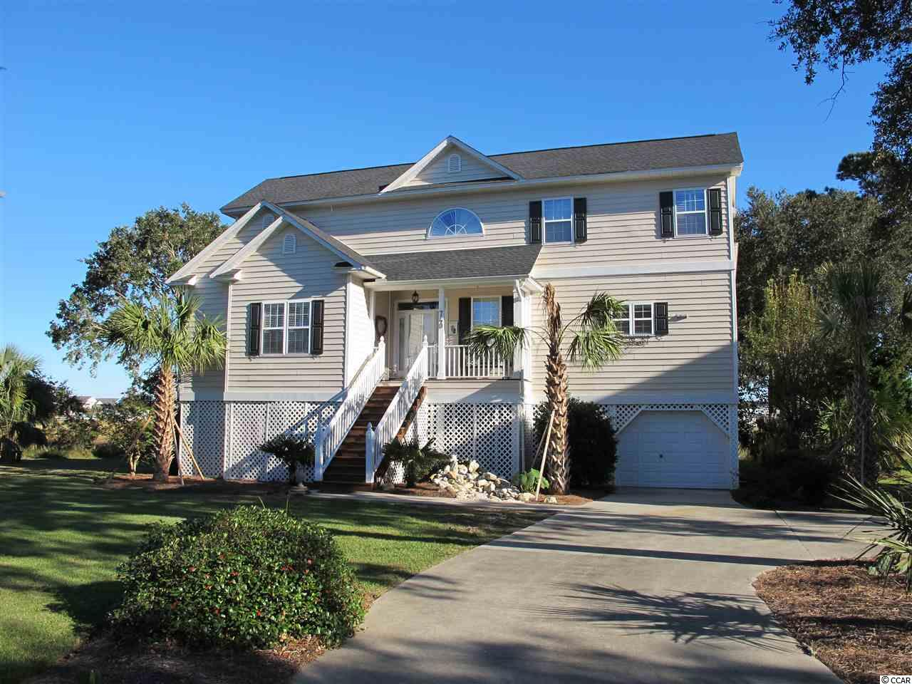MAGNIFICENT Custom built home. Your clients will love this home and serenity yet so close to the beach.  740 Elizabeth Drive @ SOUTH MARSH. This is a laid back and hidden treasure community located in Garden City Beach. Here you will find spanning marsh views that are spectacular day and night. Sit out on the porches and watch the wildlife and the harmony of the birds singing. Take a short golf cart ride to the beach.   This home is eloquent that flows so well. Featuring hardwood floors, plantation shutters throughout, new kitchen countertop/backsplash with premium exotic Brazillian quartzite. Recently painted & new light fixtures foyer and dining room. Outdoor shower & more features on the detail list. New landscaping with palm trees installed Sept 2018.  New roof 2016.  Home is also being sold furnished except for some antique family items that don't convey. Furniture was all purchased in 2015 and has had limited use.  See list of new upgrades and home improvements to this spectacular home.  Also featuring:  an elevator, and self contained living quarters downstairs on the ground floor with kitchen. Great for mother-in-law suite or keeping your kayaks and more.  Another feature transferable terminex bond & Rainbird irrigation system.  Experience the Marsh views will take your breath away. Oversized deck and screened porch to relax and view the beautiful sunrises and rainbow skies.  A beach & bird lovers delight.  Come see this home first on your list and you will fall in love with the home and features and community.  One more feature comes with 2016 Golf Cart for touring the beach,  shopping, and more adventures.   Home Warranty included with the purchase of the home.