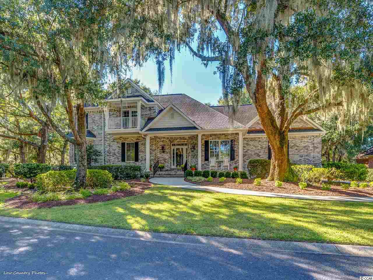 MOTIVATED SELLER. One of a kind estate home in the beautiful preserve community of Willbrook Plantation. Premier Lot. This all brick home sits on 1.5 lots and .76 acres with a stunning, private setting on cul-de-sac. Backs to natural preserve area and fronts pond and Willbrook Plantation golf course. Immaculate home. High end finishes. Kitchen has Electrolux gas range and double ovens, Bosch dishwasher, island with 2nd sink and breakfast area. Large prep room next to kitchen with cabinets for pantry, full sink and ½ bath. The living room has a gas fireplace, custom built-ins, additional half bath and extends to the large screened porch. First floor master retreat with en-suite bathroom, large dressing room and sitting area. The spa like master bath has his and her vanities, luxurious soaking tub and custom shower. There are 3 or 4 additional bedrooms.  Two of those bedrooms have their own private porch. One bedroom has custom desk space that is perfect for a home office. Additional space upstairs, 24 X 16, can be up-fitted for additional bedroom/bath since plumbing, electric and HVAC are roughed in. Tremendous storage space throughout.  Outdoor living has an immense screened porch, private deck and wonderful front porch. Meticulously cared for and updated. The garage, with workshop space, is immaculate.  Community pool, gated access and private beach access to Litchfield by the Sea.
