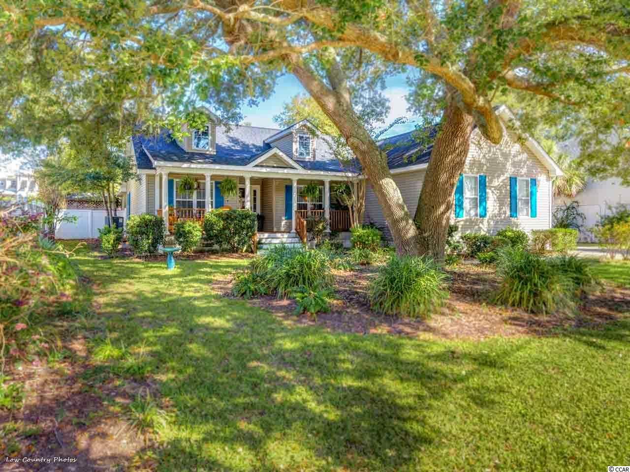 This beautiful ranch-style, open floor plan home is the perfect place for those who love to entertain! The home is placed on a well-landscaped lot and backs up to a freshwater creek, complete with an overlooking deck where you can fish or just relax. Also enjoy the private, heated in-ground pool with slide and fountain, full outdoor bathroom and large screen porch with vaulted ceilings that this private oasis has to offer. Home offers a large concrete driveway where you can easily park your RV, boat and other vehicles. Included with the purchase of this home is a private dock at the end of Edward Ave., which offers salt water access. Easily boat from your dock around the inlet down to the marsh walk, or enjoy a short golf cart ride instead! An incredible live oak completes the front yard, adding shade and beauty you can enjoy from the front porch. Schedule your showing today and experience this one of a kind home in Murrells Inlet!