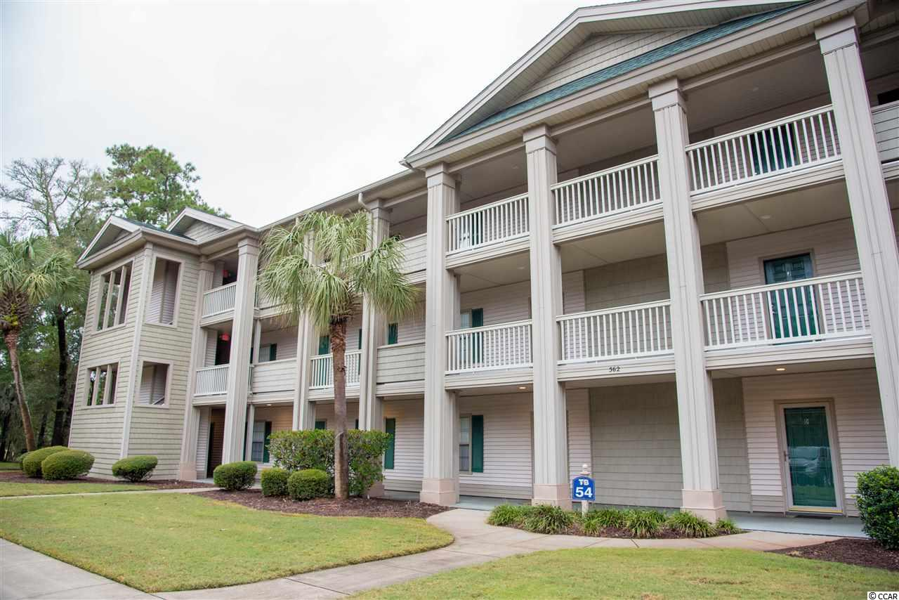 Lovely second floor, end unit condo, two bedroom, two bath, in the beautiful True Blue golf course community. Very quiet and private cul de sac with plenty of parking. Come prop your feet up and relax on your screened porch while sipping your morning coffee or afternoon cocktails and enjoy the spectacular view of the golf course. A true golfers paradise as well as community pools, tennis courts, clubhouse,restaurant and pro shop. Owners have reduced rates at True Blue and Caledonia golf courses. A perfect Pawleys Island location for restaurants, golfing, beautiful beaches, schools, healthcare, shopping and entertainment. Public access to beaches and the intercoastal waterway. Call to view this lovely Condo today!