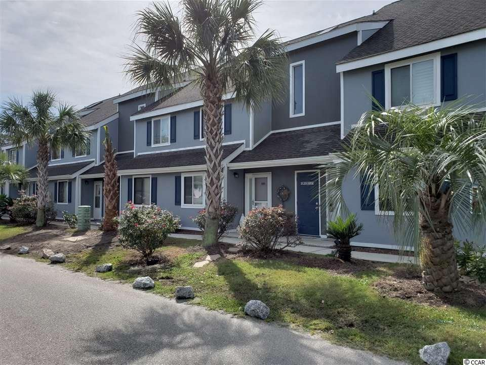 Beautiful 2 bedroom, 2 bath townhouse located in the highly sought after complex of Golf Colony in Surfside Beach. Bring your pet! This unit is located approximately 1.5 miles to the ocean, and conveniently located to restaurants, bars, and shopping. This townhouse is situated on the second floor and offer gorgeous views of the pool and terrace. This is a very open floor plan and the vaulted ceilings really contribute to the spaciousness! The master bedroom is located on the first level along with the kitchen, full bath, utility closet, living area, and washer & dryer. Furthermore, the spiral staircase leads to the 2nd bedroom loft. The loft has a full bathroom and closet for storage. This is a really neat unit that you've got to see!