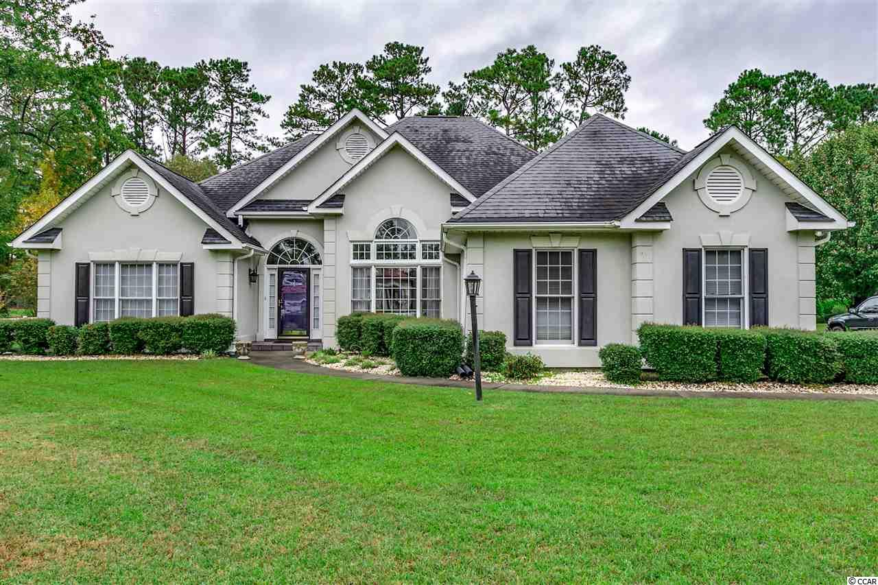 Great buy in Southcreek at Myrtle Beach National. Enjoy this sprawling ranch that features: 4 bedrooms, vaulted ceiling in family room with fireplace and built ins, formal dining area with laminate hardwood floors, stainless steel appliances, oversized master suite with walk in closet, dream screened porch overlooking Golf Course, lush landscaping and more!