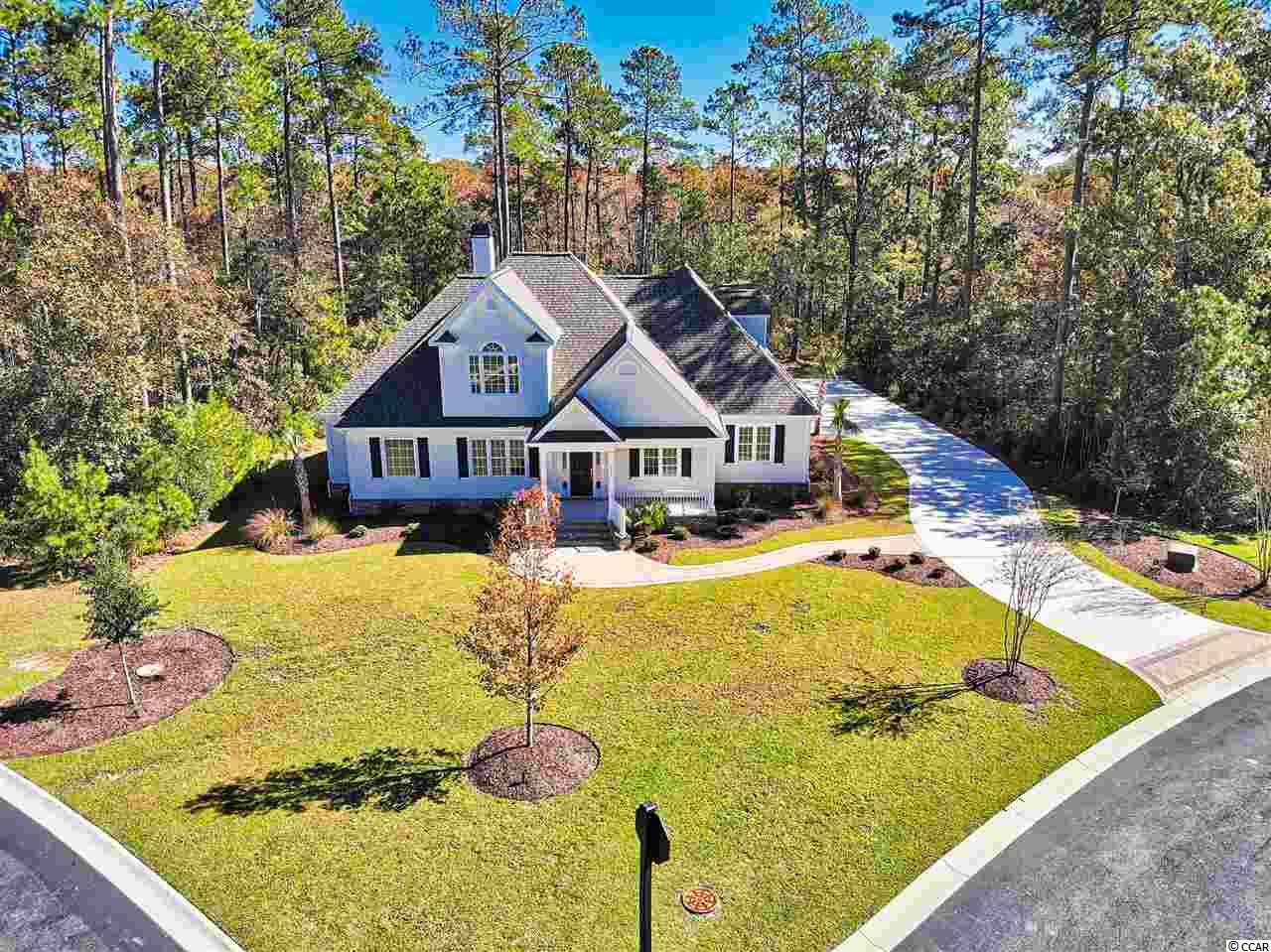 This home checks all the boxes! If you are looking for house that boasts beautiful craftsmanship, located directly on the Collins Creek for quick and easy access to the river, and is also in the award-winning St. James school district...look no further! Welcome home to 401 Cypress Wood Court! This breathtaking home located in the gated community of Bellwood Landing is situated on a private, wooded creek front lot. This custom home features four bedrooms, three and one half bathrooms and a three car garage. The open floor plan includes a custom kitchen complete with breakfast area as well as a large family room with fireplace, walk-in pantry, laundry room and mud room. The fourth bedroom and full bathroom are upstairs and would be perfect for an older child or guest suite. The attention to detail is immediately evident upon entering the master bedroom suite with a tray ceiling, crown molding and large windows offering an abundance of natural light. The large walk-in shower and stand-alone tub, combined with the his and her vanities may convince you to never leave the master bathroom, not to mention the HUGE walk-in closet with built-ins! The outside living space will allow you to take full advantage of the beautiful South Carolina weather with a large screened in porch as you enjoy your 1+ acre property with 100 feet on the Collins Creek with the dock permit already in place! Nearby private amenities include a pool, tennis courts, picnic tables, a covered pavilion, play equipment for children, and walking trails throughout the 40 Acre Park. And you will be within ten minutes of a modern hospital, shopping, Murrells Inlet famous dining, and, of course the sandy Atlantic Ocean beaches. And SC's only TPC golf course is a very short walk away.