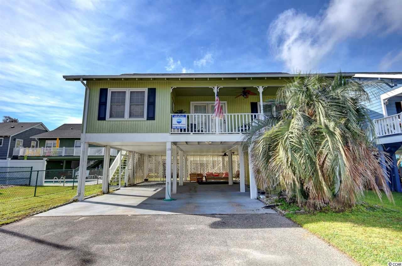 Don't miss the opportunity to own your slice of paradise with this raised beach home in the Garden City area. Your family will love making memories in this three-bedroom home along with two full bathrooms. You will love to hear the sound of the ocean, the smell of the marsh and salt air, and the light that flows through this home away from home. The split bedroom plan offers privacy throughout the home, and the quaint living and dining area is the perfect spot to gather everyone around for some great quality time. The galley kitchen with a custom back-splash is fully equipped for cooking up a feast for your guests. The master bedroom with its' own private bathroom features a walk-in closet, a ceiling fan, and a shower/tub combination with single vanity area. The other bedrooms feature ceiling fans as well and come with access to a full bathroom featuring a walk-in shower and single vanity area. The home is located only a short walking distance or golf cart ride away from the Atlantic Ocean where you can take a dip or enjoy the sand between your toes. The porch area and underneath the home are the perfect outdoor spots to soak in the scenery, sounds, and smells that surround the home. This would make the perfect primary home close to the beach, second home, or rental property. Garden City has some of the best dining, shopping, and entertainment, and it is in close proximity to Myrtle Beach and Murrells Inlet. You don't want to miss the opportunity to view this piece of paradise.