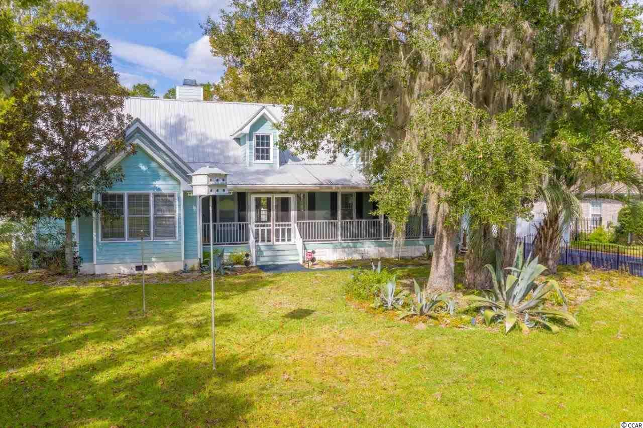 True boaters true paradise, best kept secret! Located on a quiet canal near Wacca Wache Marina, literally a few minutes from the Intracoastal Waterway (ICW). This low country style home has an inviting wrap around front porch. The home sits on a cul-de-sac of this very private neighborhood with no HOA. The open floor plan showcases the grand all natural stone fireplace. The kitchen, perfectly set for entertaining, with granite counter tops and island, opens to the breakfast area and living room where you can enjoy the view of the pool. A swimming pool, deck, screened back porch and dock are added features in this 3 bedroom, 3 baths and great bonus room which could be a man cave or an entertainment/media room home. New whole house generator. Boat dock right off the back yard - no long boardwalks to floating dock like other waterfront properties. Access the Waccamaw River/ICW from your back yard and be on your way to as south as Miami or as north as Boston. Square footage is approximate and not guaranteed. Buyer is responsible for verification.