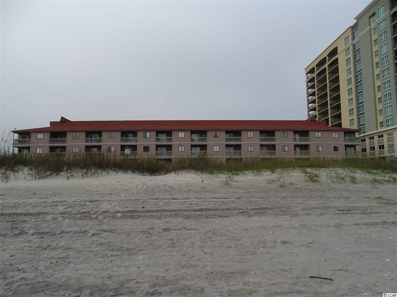 Rare find! 2BR 2BA ocean oriented unit in oceanfront building on popular OD section of North Myrtle Beach. This end unit is well maintained and is offered for sale fully furnished, excluding personal items and contents of owners closet. Recently improved with new kitchen cabinetry, appliances and many new furnishings including dining area, television storage stand in living room as well as all new mattresses. New plumbing fixtures in both bathroom tubs. Upgraded with tile flooring in all public areas, newer HVAC, washer and dryer as well as water heater. Spacious interior owners closet also includes area for washer and dryer. Outdoor pool and inviting deck area with direct walkway to the beach. Solid HOA with lower fees which includes building insurance. Ideal investment property or vacation getaway. Convenient to all the attractions of North Myrtle Beach as well as access to the Robert Edge Parkway. Don't miss this opportunity.