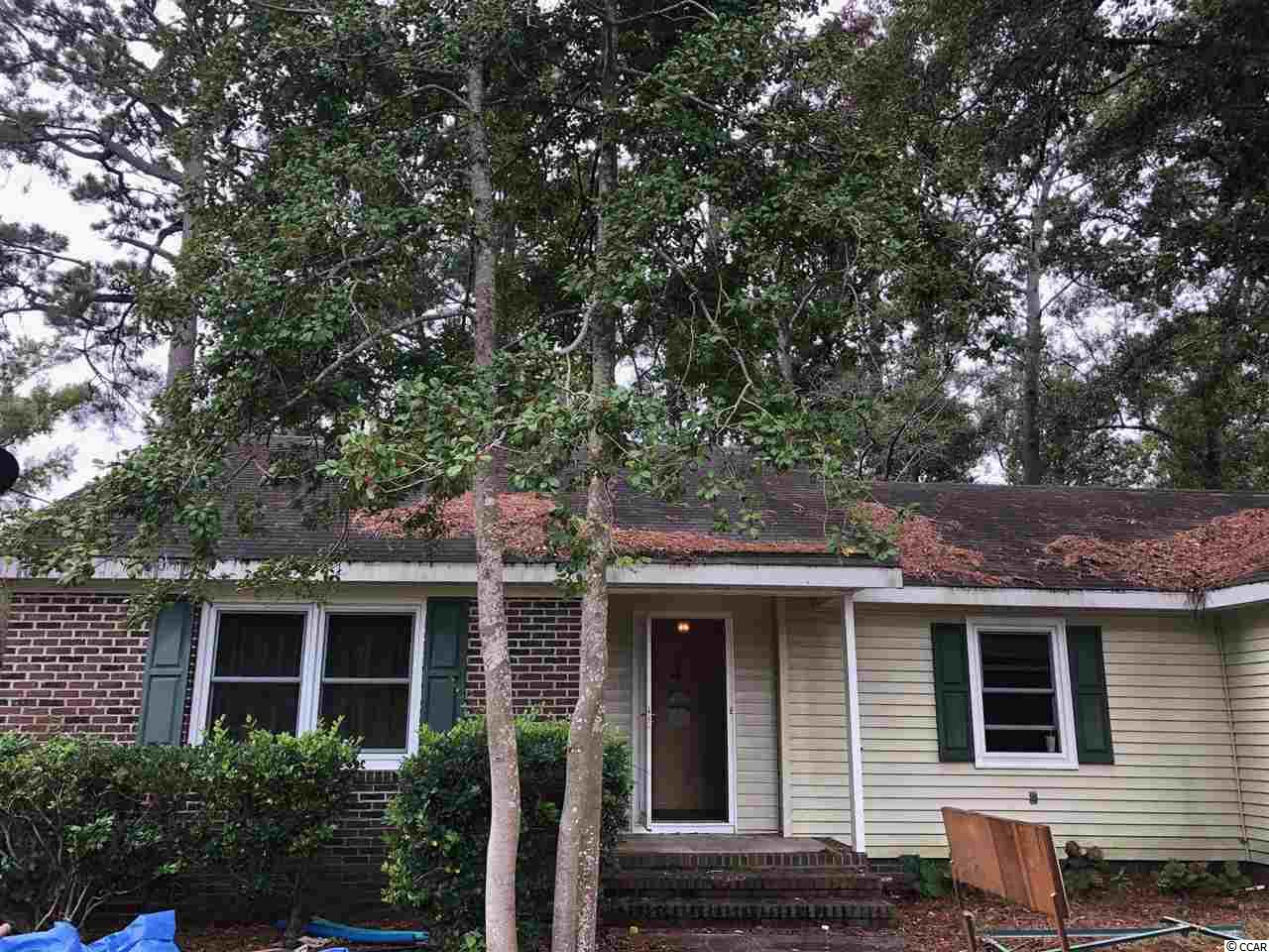 Calling all investors! This home is in need of a makeover, but is in an incredible location just a short walk or drive to the beach! This ranch style brick home is located east of 17 in the popular Surfside Beach area. Great potential for a flip or long term rental.