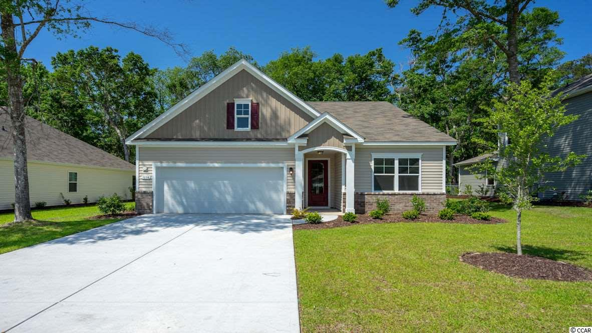 "Come out to see why everyone is deciding Waters Edge is the community to live in! Easy living at its best! This beautiful Acadia plan is nestled on a wooded lot! Come see this low maintenance, gated neighborhood! Mature trees and beautiful inlet view at Water's Edge! This home has 3 bedrooms, 2 baths, with a 2 car garage! Open concept floor plan! Kitchen features granite countertops, recessed and pendant lighting, and Frigidaire Gallery stainless steel appliances. Laminate flooring in foyer, dining, living, and kitchen. Carpet in bedrooms and porcelain tile floors in baths and laundry. 5 1/4"" Base Boards & Crown Molding in the main living areas. Fully sodded lawn with irrigation. Lawn Maintenance is included in the HOA. Home and community information, including pricing, included features, terms, availability and amenities, are subject to change and prior sale at any time without notice or obligation. Square footages are approximate. Pictures, photographs, colors, features, and sizes are for illustration purposes only and will vary from the homes as built. Equal housing opportunity builder."