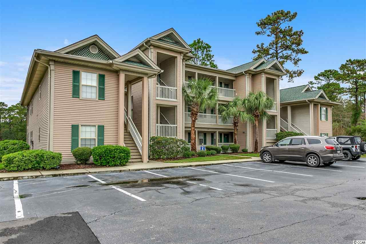 There is no need to look anywhere else for a condo in True Blue because this one is for you. The owner has installed new light fixtures, LVT flooring, new paint, and carpet in bedrooms. The condo features one of the best views of the par 3 hole at the True Blue Golf Resort. The kitchen opens to the main living area. The master bedroom features a huge walk-in closet. One of the many things that is important to know is the condo features a full size washer and dryer which is hard to find in a 2 bedroom condo. All you will need to do when you purchase this particular condo is bring your golf shoes or flip flops for the beach. True Blue Community features several pools with hot tubs, tennis courts, gazebo and picnic areas throughout the community. Make sure you put this condo on your list to view with your Realtor today. This condo can be show ANYTIME and it is waiting for you!