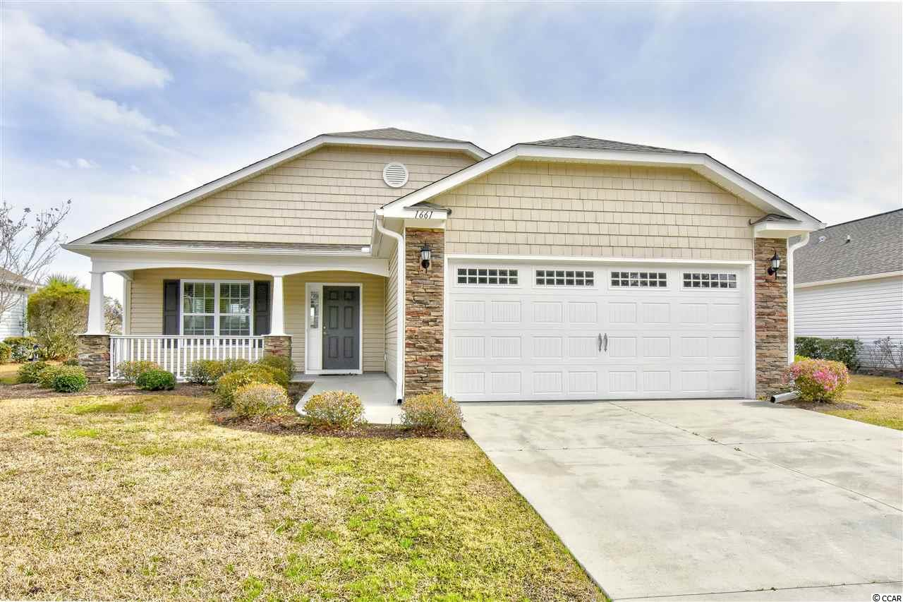 Must see this 3br/2ba home on a great lake lot in the Gated community Surfside Beach Club - The Chalets! This home features on open floorplan w/ nice sized bedrooms, laundry room, open kitchen, dining, living areas, vaulted ceiling, screened porch & back patio for grilling with awesome lake/fountain views, newer gutters, nice yard and 2 car garage! On top of this fantastic home, Surfside Beach Club offers low HOA Fees and wonderful amenities including an olympic sized swimming pool, fitness room and clubhouse and is conveniently located close to all of the shopping, dining, entertainment, golf, area attractions, MB Airport and of course the beautiful Atlantic Ocean w/ 60 miles of white sandy beaches! Whether your primary residence, an investment or your vacation get-a-way, Don't Miss ~ come live the dream!