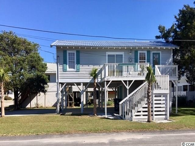 Raised beach house in Cherry Grove section of North Myrtle Beach. Situated on 2 corner lots and NOT on a thru street. Comes furnished and professionally decorated. Completely remodeled in 2012. Not used as a rental since remodeling. Flex room that could be used as an extra bedroom. Kitchen, dining, living room combo with plenty of light in all rooms. Storage area below to store your golf cart, beach chairs, & other items. Additional enclosed bathroom facilities downstairs with shower! A must-see, for sure. Square footage is approximate and not guaranteed. Buyer is responsible for verification.