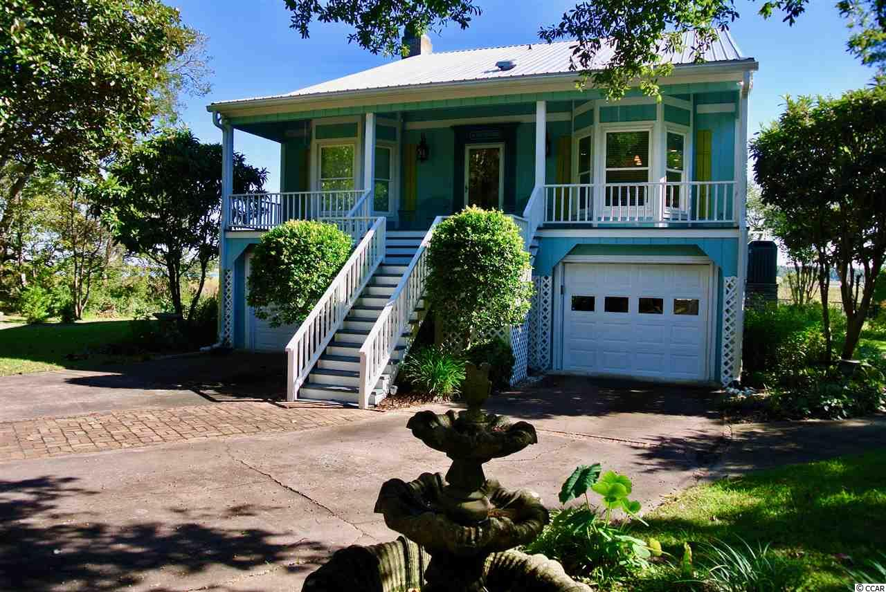 1 acre of Panoramic Inlet views over Huntington Beach State Park, Drunken Jack island, Murrells Inlet Jetty's and Garden City Beach! Hunting Marsh neighborhood is located contiguous to Huntington Beach State Park on the South end of Murrells Inlet near and across from wildlife preserve Brookgreen Gardens. It's a super quiet 30 lot neighborhood with one way in a and one way out. Please come visit this home and neighborhood to see for yourself how exceptional this listing is. This 3 bedroom, 3 full bath home features a third level master with views over Inlet, completely remodeled kitchen in 2017 with quartz countertops, new cabinets, gas range, new center island, enclosed Carolina room overlooking rear deck/pool, ground level workshop in garage, ground level covered area by pool....Minutes from the beach. Enjoy a stroll along the 18 mile Waccamaw nature bike path. Schedule a private showing today!
