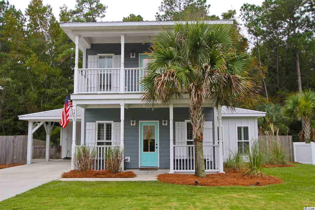 Wonderful low country style home with rocking chair porches on upper and lower levels. Open floor plan. Luxury vinyl plank flooring. Board and Batten and beadboard paneling add a wonderful dimension to this unique home. Neutral colors throughout, granite counters in baths. 2 decks provide great space for outdoor living. Fenced yard and outdoor storage. Hardi-plank siding and metal roof. Great location - ride or bike to the beach. New HVAC in 2018.
