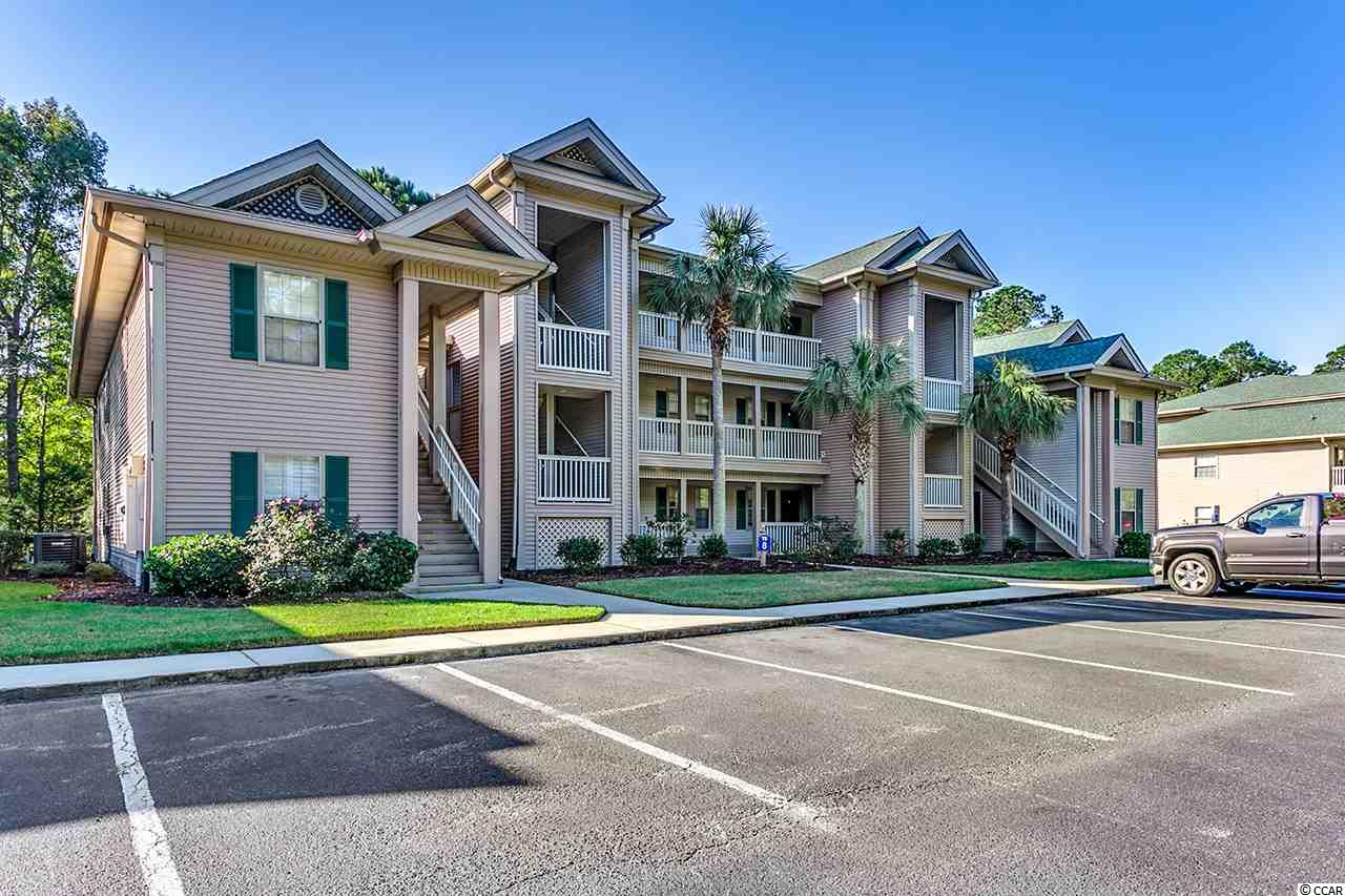 True Blue Pawleys Island ground floor. This 2 bedroom 2 bath furnished condo is offered by the original owner, never on a rental program. No wallpaper in bathrooms, lightly used, little, if any wear and tear, neutral, custom paint colors, ready for the new owner. Screen porch (18'6x6) with view of 17 tee thru lightly wooded area and set back far enough so you won't be disturbed, accessed from the Living Room and Owner Suite. Covered, secure outside storage for golf clubs, beach stuff or bicycles. Monthly service fees at True Blue include the following: water, sewer, basic cable, HTC broadband internet, insurance (excludes interior insurance), common area maintenance, exterior building maintenance (includes power washing), lawn and landscape, pool, tennis, security, trash, pest control, reduced golf rates at True Blue and Caledonia, approximately 3 miles to the nearest public beach access and short walk to pool. One year Home Warranty provided for added peace of mind. Family or individual golf memberships available for extra fee, includes range, practice facility, Caledonia and True Blue golf courses. Perfect vacation home, permanent residence for those who wish to downsize or income potential property.