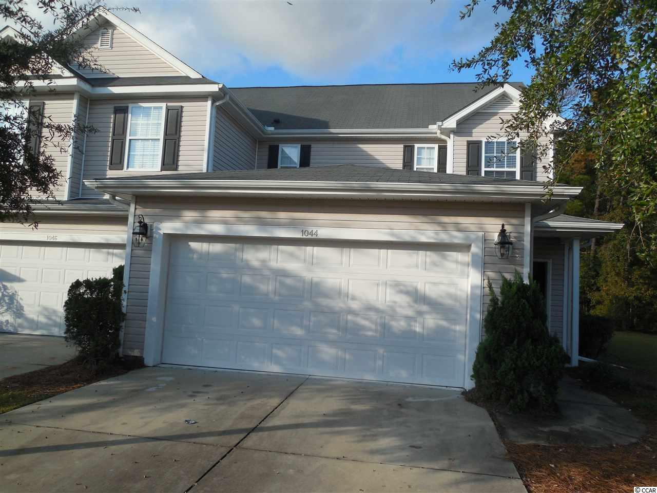 Great end unit townhouse on the largest lot in the Fairways at Wild Wing. Lot 63. It has a beautiful open floor plan with a two story cathedral ceiling in the living room. A first floor owners suite with an extra large walk in closet and en suite master bath with linen closet. There is a half bath off the living room and a sliding glass door for access to the patio. The kitchen has plenty of cabinets a breakfast bar and a pantry. Additional flex room on the second floor with the two other bedrooms a full bath and a good size laundry room with washer and dryer. Home has had brand new carpeting put in most areas. It features an attached private 2 car garage with opener. This town home is a great investment property or a wonderful home for a primary residence or a secondary residence. The Fairways at Wild Wing community is sought after because its close to shopping, restaurants and Coastal Carolina University and just 20 minutes to the beach. It has nightly security, a beautiful pool and lawn maintenance. Cable and internet are also included in the HOA. All measurements are approximate and not guaranteed. Buyer is responsible for verification.