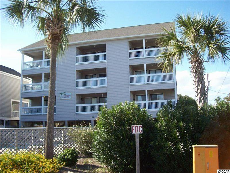 Two bedroom/one bath 2nd row condo with ocean view. Tropical Sands is a low-rise 9-unit building with a pool with beach access directly across the street. This unit is sold fully furnished, has a large balcony, and has been very well maintained by the current owners. Square footage is approximate and not guaranteed. Buyer is responsible for verification.