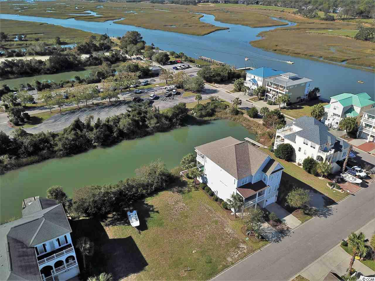 This waterfront lot is located in the beautiful, upscale community of Heritage Shores in Cherry Grove.  Dock permit has been approved.  The community features no HOA fees, boat ramp & dock, a nature trail, and it's located just a few blocks to the blue Atlantic.
