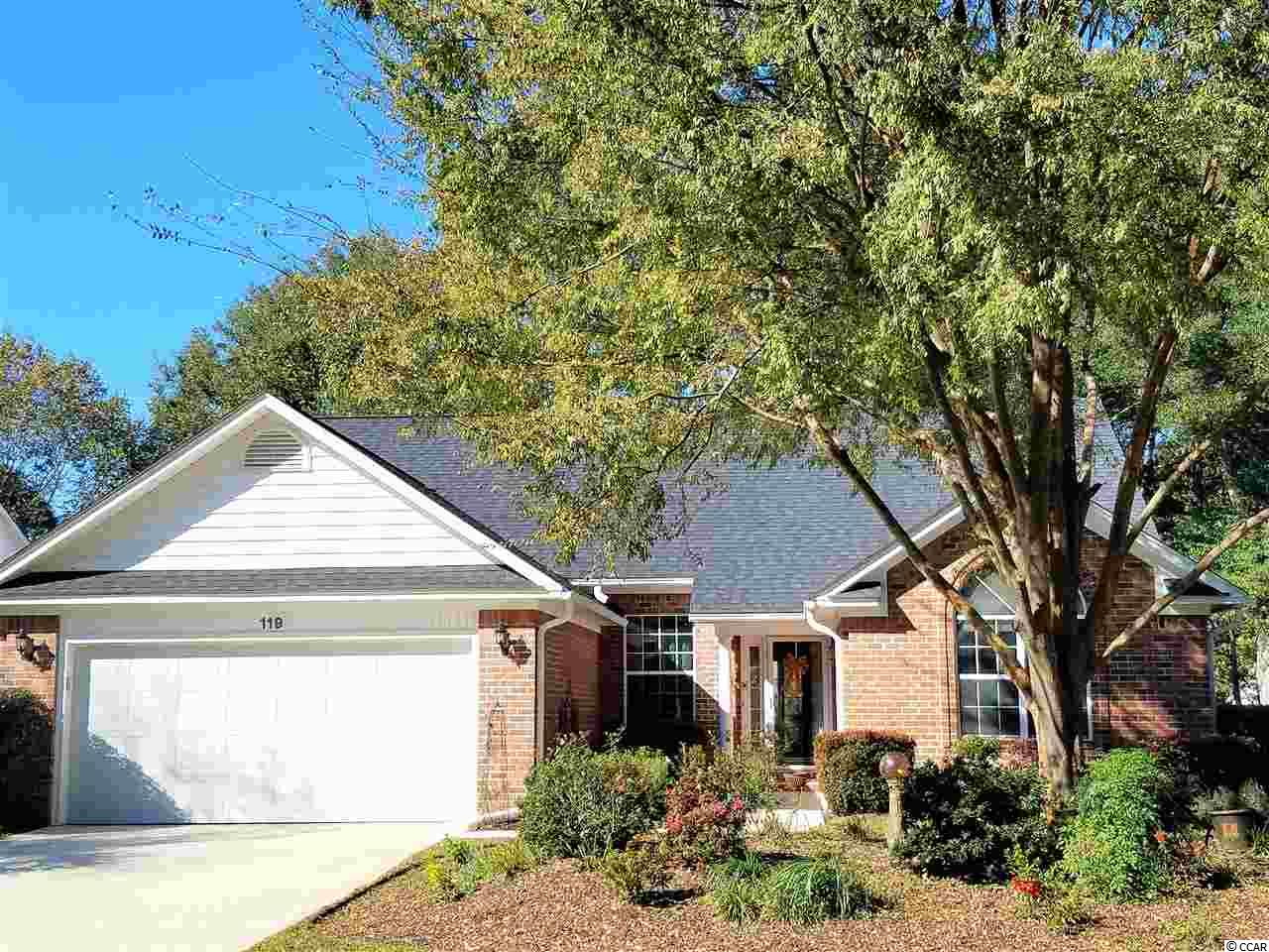 Welcome to one of the nicest, private communities in Pawley's Island. This home is located on the Top Notch River Club Golf Course. Sit on your back patio and enjoy the view of the 12th Hole and the lake beyond! This all brick, one owner home shows immense pride in ownership. Big, open floor plan with all tile floors in the LR/DR/KIT that keep the house cooler in Summer and are perfect for beach living. Important updates are a new roof in 2015 and 15 Seer Trane complete HVAC system. Rest easy as this home is not in the Flood Zone! The River Club is gated for your safety and privacy. It has a beautiful private pool and of course the golf course and clubhouse are right at your fingertips. Don't forget as owners in The River Club you have access to the Oceanfront Amenities at Litchfield by the Sea. This means easy beach parking in the Summer with access to the sun decks, clubhouse, outdoor showers and bathrooms. Homes like this sell quickly in The River Club so come take a look. If you wait it might be gone!