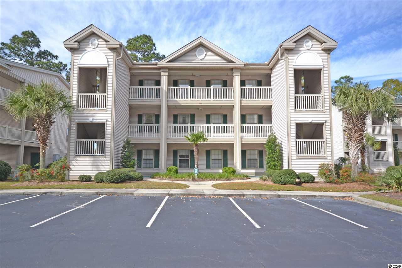 Fantastic golf course views from this freshly painted fully furnished 3 bedroom, 2 bath condo in True Blue II. The large picture window takes advantage of the natural light and the screened porch is the perfect place to enjoy the views. This second floor unit is conveniently located across from the community pool this condo is also close to fine dining, tennis and of course golf! Also it is just a short drive to the beaches on Pawleys Island as well as the Hammock Shops. Location and condition makes this condo move it ready for a perfect vacation get away or a great place to call home. Don't miss this one!