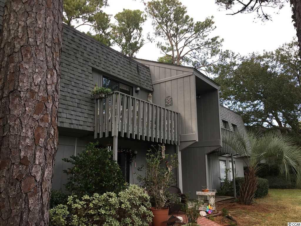 What a lifestyle. Short walk or bike ride to Litchfield Beach. Relax in this charming 2-bedroom condo located in the Salt Marsh Cove Community. Used as a second home. Beautifully decorated and furnished with a Palm Beach flair. Terrazzo tile throughout common areas and wood look laminate in bedrooms. Balcony overlooks scenic pond and spacious grounds with lots of trees and shrubs. Storage closet offers plenty of space for beach and sports equipment. Salt Marsh Cove features a community pool, clubhouse, picnic areas and a dock on the creek, ideal for launching your kayak or taking in a morning sunrise. Conveniently located to Brookgreen Gardens, Huntington Beach State Park, restaurants, shopping and top-ranked golf courses. Historic Charleston is 60 miles south.