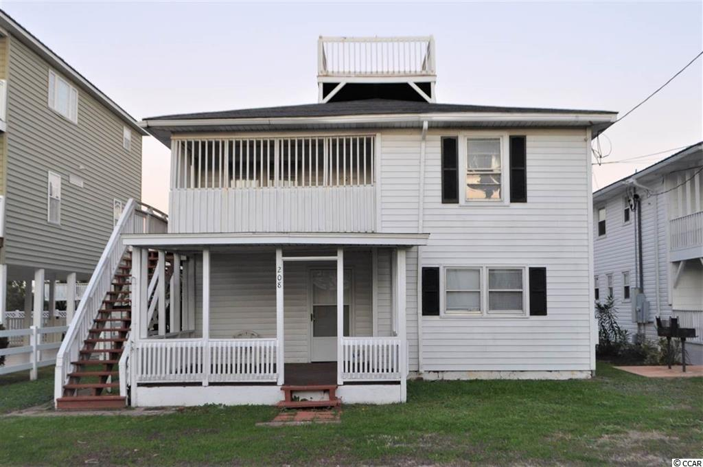 Enjoy the Cherry Grove beach life in this 4 bedroom, 3 bath 2 story duplex. Home features include tile throughout first floor, two bedrooms each with its own bath and a large covered porch. The second floor has a spacious living area, 2 bedrooms with 1 bath and a large deck and widows walk up top for taking in the sparking ocean and sunset views. Large fenced in yard perfect for a pool! Only a few steps from the white sand and surf makes the perfect location for a second home for weekend getaways and you can use the other half for an investment property or rent out both! Located on a private street with a fresh water lake at one end of street and the ocean at the other, it doesn't get better than this! Don't miss out on this amazing ocean view investment property in the popular family friendly Cherry Grove Beach!