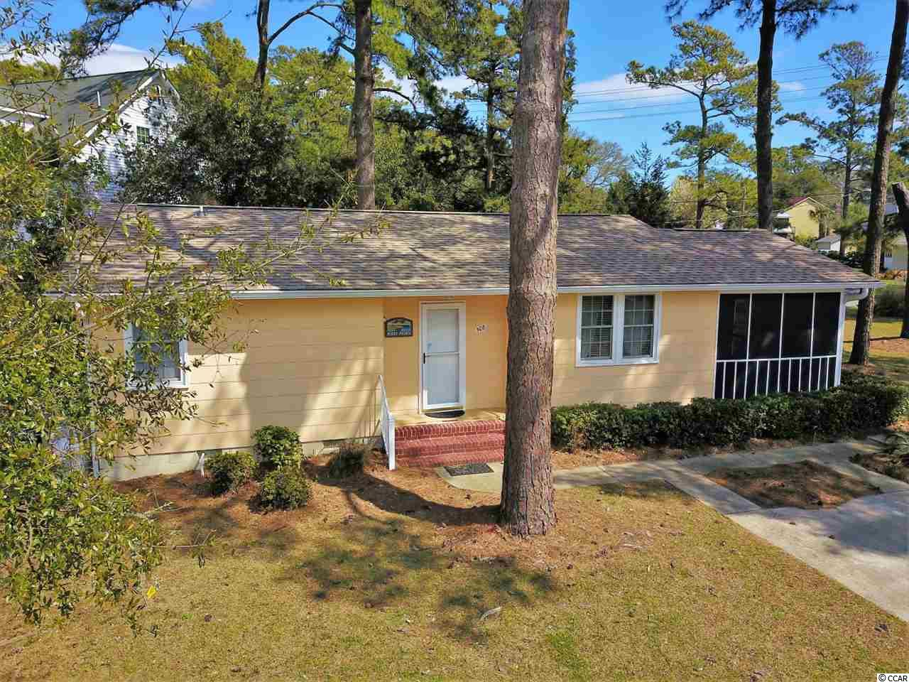 Absolutely adorable beach cottage on an oversized lot just a short 4 block walk to the beach! This 3 bed, 2 bath home has newer roof, HVAC, electrical fuse box, and water heater. The seller has done a lot to get this home updated and ready for a new owner. New countertops in kitchen, the exterior has been recently painted, and new carpet and padding throughout. Enjoy your large screened in porch while overlooking the serene yard- or take a stroll and put your chair in the sand at Windy Hill beach in North Myrtle. There is a deck off the back and a separate storage building. All information is deemed reliable but not guaranteed. Buyer is responsible for verification.