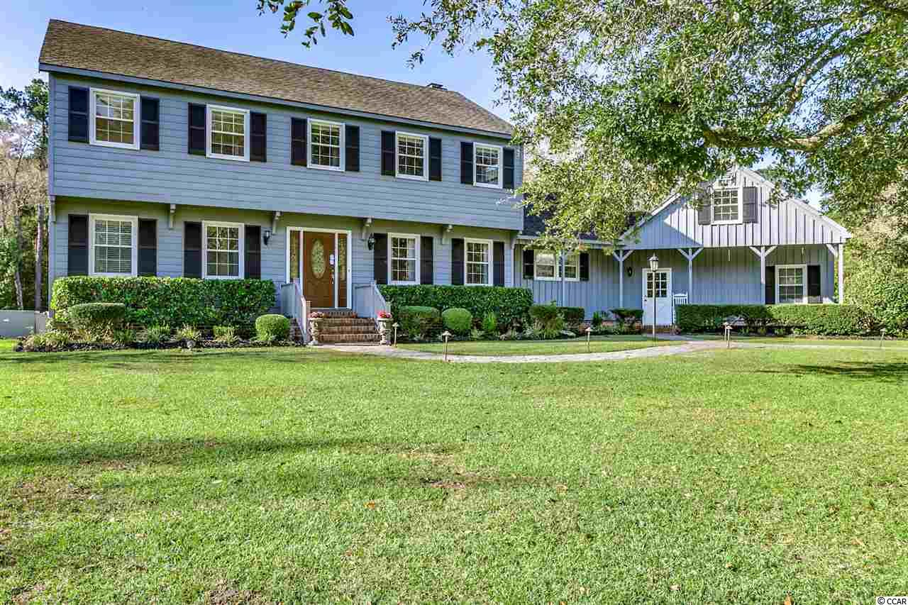 4 BR/ 3 1/2 BA home located off 701 S situated on approximately 3.98 acres. This well maintained home has much to offer with its quiet country setting and privacy. The kitchen features granite counter tops, breakfast nook, double oven, built in desk area. Sunken family room has gas logs, built ins and hardwood floors. Formal dining area has chair rail molding and crown molding. Master suite has 2 walk-in closets. Hardwood, tile and carpeting throughout. Detached shed with power. A deck overlooking the nicely landscaped backyard. The yard is completely fenced in and has a gated entrance to the property. This home is a must see!