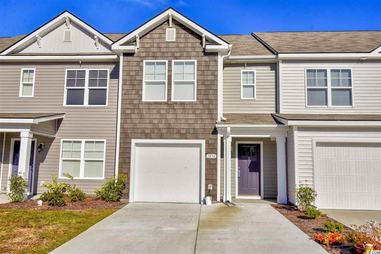 This beautiful 3 bedroom 2.5 bathroom townhouse with private garage is located in the Fairways @ Wild Wing. Move in ready! Still like new-owner purchased new in June 2018. Enter through the foyer and step right into the living area. This home offers an open floor plan space that is perfect for everyday living and entertaining. The kitchen is all a chef could ask for with over-sized work island, granite countertops, stainless steel appliances, pantry and more. The serene master suite features vaulted ceilings, a ceiling fan, walk-in closet, double vanity sinks granite countertops with and a walk-in shower.The two other bedrooms have vaulted ceilings, ceiling fans and share a bathroom with a vanity sink and tub/shower combination. Step outside and relax enjoying a cup of coffee or evening cocktail on the extended patio. Neutral colors throughout are the perfect palette for any decor. Builder warranty conveys and expires in June 2019.The low maintenance backyard offers privacy panels, gutters and is fenced in. On top of this fantastic townhome, Fairways offers a community pool and is close to CCU, Conway Hospital, shopping, dining, entertainment, golf, area attractions, the beautiful Atlantic Ocean and all that the beach has to offer! Don't Miss out! Come enjoy this peaceful neighborhood!
