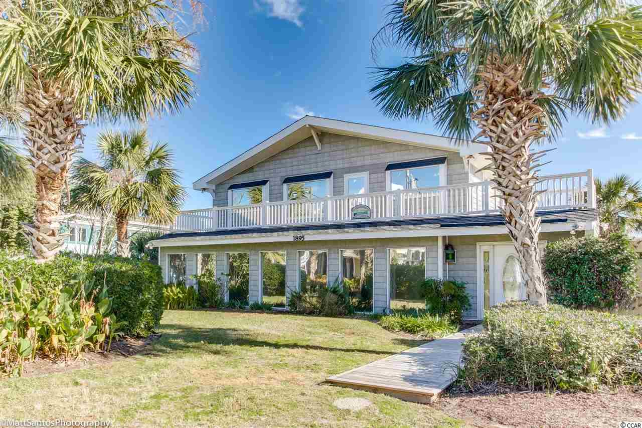 RARE opportunity to own your creek front home in Garden City Beach. This beautiful 6 bedroom, 4 bath home has been used as a 2nd home and has been meticulously maintained. Home is being sold furnished except for some personal items. Features include 2 spacious family rooms, 2 full kitchens, front and back porches, floating and fixed dock that can accommodate large boat. Enjoy a sunset cruise on the inlet or fishing in the Atlantic within minutes. Great space for entertaining outside and enjoying your own private pool!!