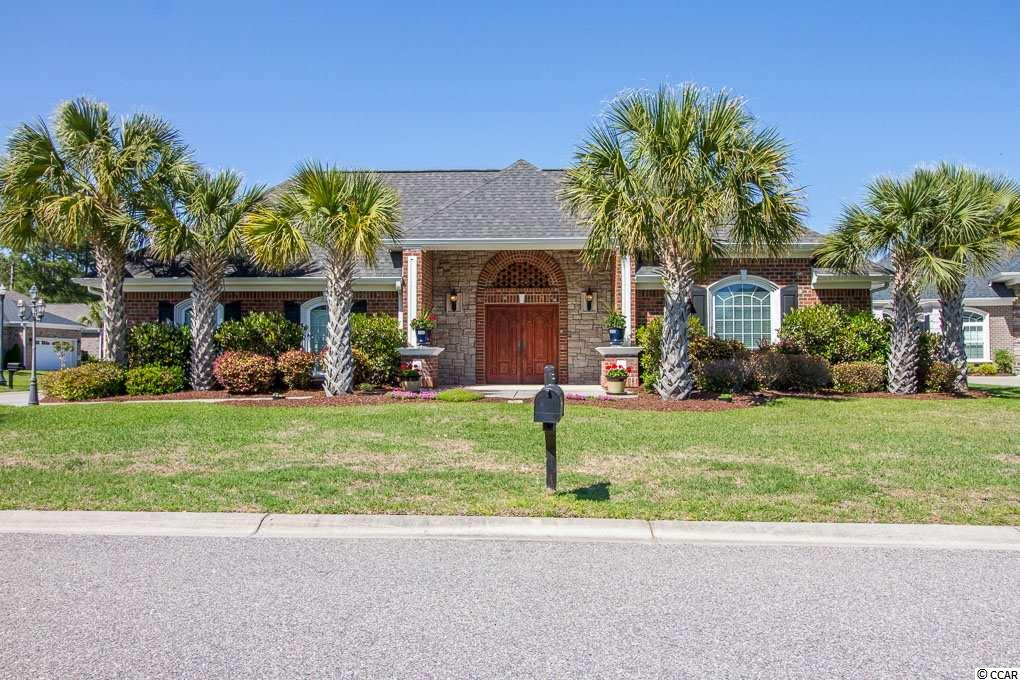ONE OF A KIND CUSTOM ALL BRICK HOME ON CORNER LOT! Beautiful 4 BED 3 FULL BATH COURTYARD HOME situated on a large corner lot in the private gated Waterfall community. Ideal location and only 5 minutes to the beach & shopping in North Myrtle Beach. The grand front double door entry opens into a private secluded courtyard with an outdoor pool and hot tub! Custom features throughout the entire house with an open & spacious floor plan! Custom features include Brazilian hardwood floors, Granite/Marble countertops, custom cabinets, crown molding, 12 ft Architectural ceilings, recess lighting with dimmers, custom light fixtures, fireplace, surround sound, security alarm system & intercom system. Huge Gourmet kitchen with a 5 ft Stainless Steel refrigerator, plenty of cabinets and long countertop bar. Large dining area too! Home features a SPLIT FLOOR PLAN! One wing of the house is the large Master suite with a sitting area & huge walk in closet! Custom Master bath is large & spacious with beautiful separate vanities and plenty of drawers for storage, linen closet, garden tub & separate large tiled walk in shower! Luxury galore! This house boasts a totally separate courtyard entry & private guest suite, Mother-In-Law suite, entertainment room or Man Cave with a full bath that has an amazing view of the outdoor in-ground 13x14 splash pool & above ground Grand Bahama Hot Tub! The courtyard is surrounded with private walls for an ideal tranquil setting. Open & spacious large back yard too! Waterfall amenities include the Amenity Center with private owner access entry only, outdoor pool, outdoor/indoor kitchen, bathrooms, great room and 2nd floor fitness room. The Amenity Center is great for meetings, entertaining, or catering a special function. Waterfall is in an ideal location close to all major highways, 5 minutes to the beach in NMB, shopping, hospital, medical offices, restaurants and bars, Shag clubs, golf & the NMB Sports Complex. Square footage is approximate and not g