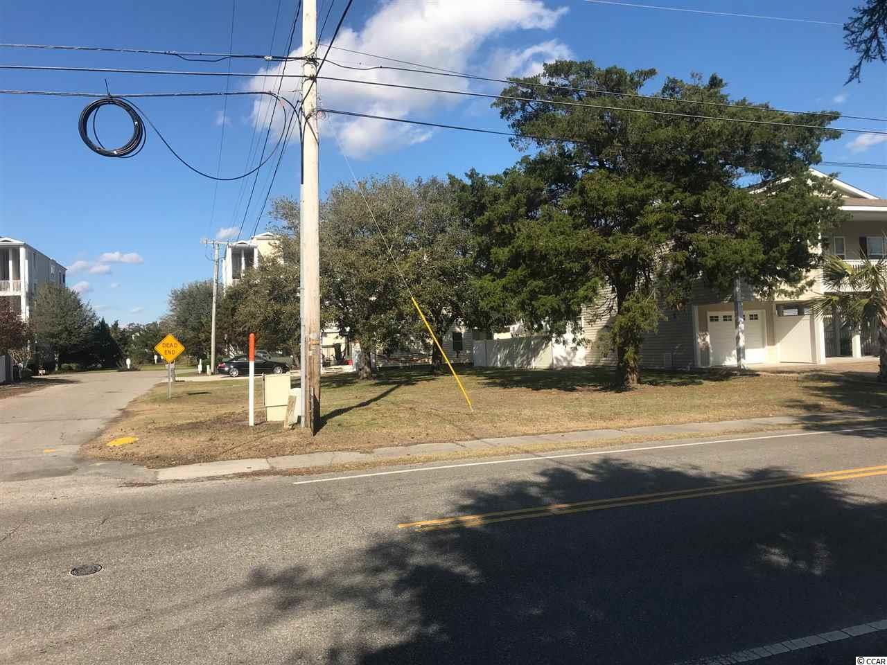 Only 3 blocks to the beach!!  Build your beach house or investment property on this cleared, level, corner  lot that is centrally located in Cherry Grove, with marsh only 100 yards away.  Great location across from Boulineau's, which has everything you will need! Hurry and grab this one up because  they aren't making any more land!