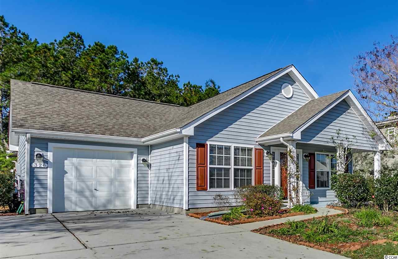 "Here's your chance to live in the golf course community of ""Highlands"" at The International Club, Murrells Inlet. Located across from a stunning lake the home has a nice sized yard with privacy, backing up to woods. This single level 3BR/2BA home is full of natural light and features high ceilings. Upon entry the open living/dining area share a soaring cathedral ceiling. The spacious kitchen features numerous upgrades including stainless appliances, quartz counters with bar seating, pantry, inlaid backsplash, and numerous cabinetry. The oversized master suite with vaulted ceiling has a walk-in-closet, linen closet, ceiling fan, and master bath with double sink vanity & tiled shower. An all season's room offers the perfect place to unwind while enjoying South Carolina's wonderful weather. Additional features include a rear patio and exterior storage closet. Relax by the pool, join activities in the clubhouse, or get your daily exercise in the large fitness room at the amenity center. Low HOA. Just a short drive to Huntington Beach State Park and Brookgreen Gardens. Located close to Murrells Inlet with marsh walk, restaurants, beaches, golf courses, shopping and entertainment. An opportunity to live in The Highlands doesn't come often!"
