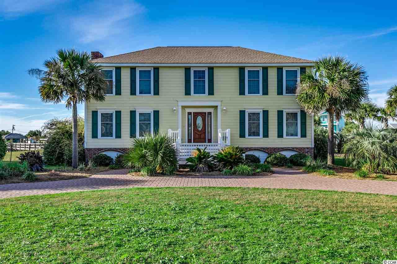 Welcome home to this fully furnished, 4 bedroom, 3 bathroom home perfectly situated on 1 acre on the marsh and second row from the beach in Inlet Harbour. This home features beautiful wood and unique brick flooring on the first floor, and tile in every room upstairs with crown molding flowing throughout. The kitchen is equipped with all appliances, plenty of cabinet space, and a work island with range and breakfast nook. The living room features a grand fireplace as a focal point, built-ins on either side, with a piano and well coordinated furnishings to fill. The very spacious master bedroom includes room for a seating area, his and hers closets, and a bench by the window overlooking the inlet. Enjoy afternoons and watch the boats go by from your air conditioned carolina room, or relaxing at the beach just a block away. Conveniently located near all of the famous dining in Murrells inlet, and close to all of the Grand Strand's finest golf, shopping, and entertainment attractions. Whether you are looking for an investment opportunity or your forever home in the inlet, you won't want to miss this. Schedule your showing today.