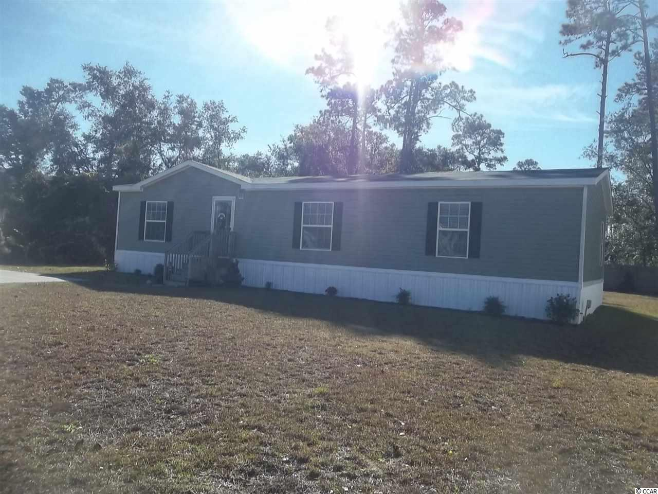 2016 model double wide. Home is in immaculate condition. 3 bedrooms, 2 baths/with laundry room off hall bath. Large, high, lot with detached storage.