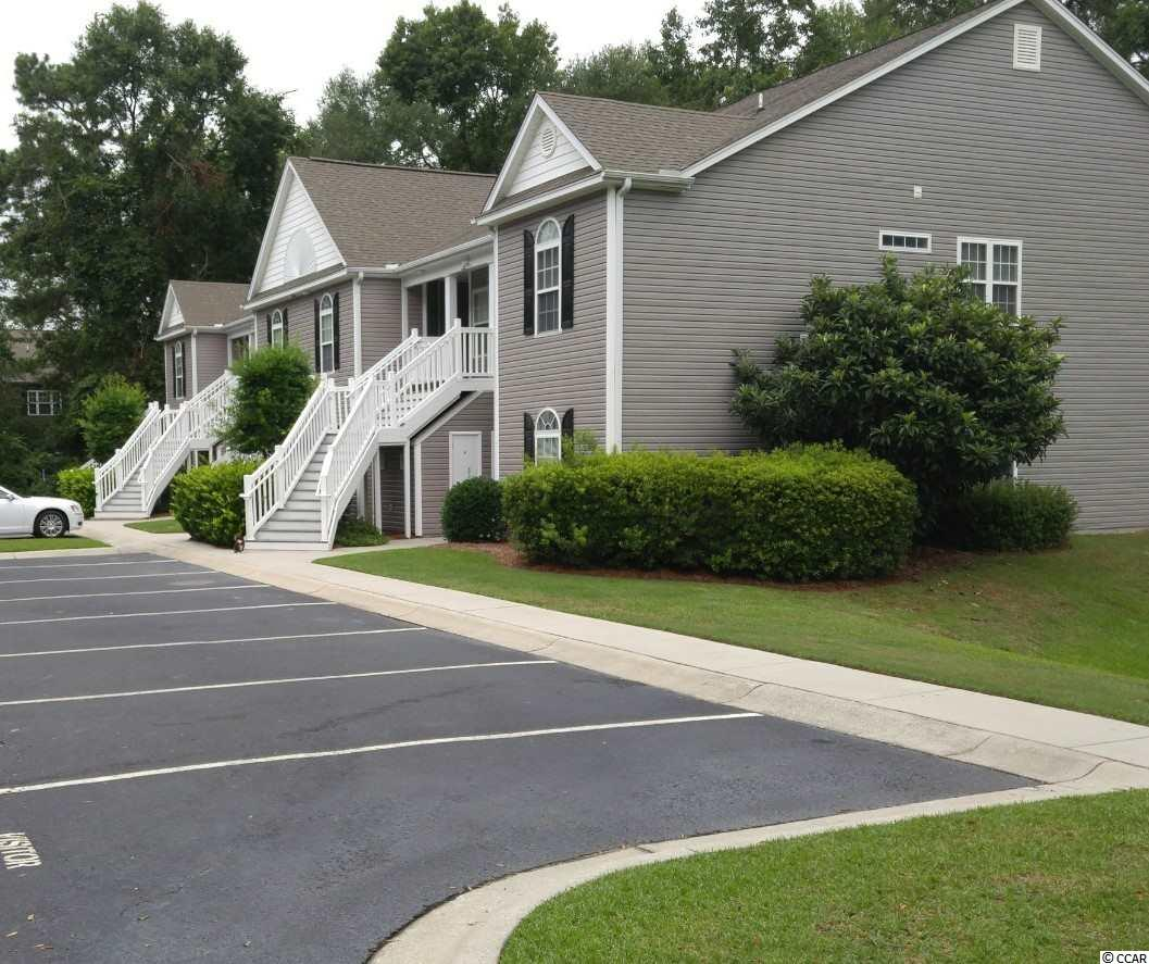 This quaint, gated community is conveniently located west of Highway 17. Centrally located in the heart of the Pawleys Island area, you will be just minutes from a wealth of shopping, dining, award winning golf courses and public beaches. Building 674 is one of the more desirable buildings in this neighborhood due to the private landscape that borders. Offering 3 bedrooms & 2 full baths, this unit is well maintained and freshly painted. Interior is upgraded with Plantation Shutters throughout. The great room is spacious and includes updated light fixtures/fan. Off the great room sits the private screened porch. There is a private exterior storage closet just out the front door. Pawleys Pavilion offers its residents and their guests a community pool and lounging area with on-site bathrooms.