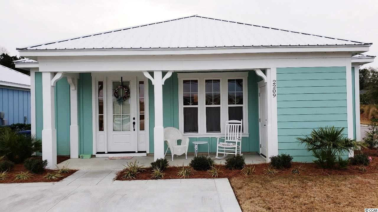 Furnished 2 BR / 2 BA bungalow with open living area, breakfast bar, master bath with tile shower & double vanity, covered front porch with storage area. Newest development in Barefoot Resort, The Retreat at Barefoot Village, located only 1.5 miles from the beach, offers the perfectly positioned neighborhood within walking distance to all the fabulous Barefoot amenities including the area's largest salt water swimming pool, golf, bike trails, and walking paths.