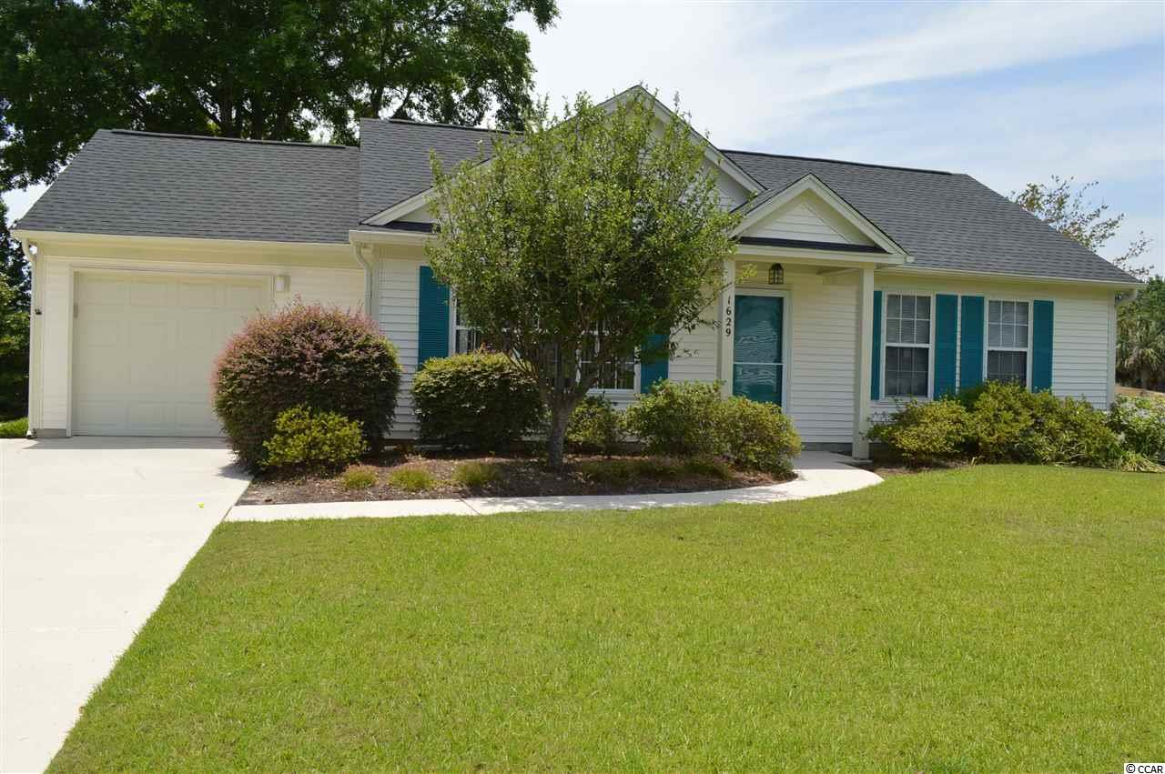 "This lovely home sits on a beautiful golf course lot in the very desirable ADULT community of Woodlake Village. Everything you could ever want or need is close by. Woodlake Village is a well established community and such an ideal location and offers so many great amenities such as clubhouse, pool, library, tennis, pickle ball and shuffleboard courts. There are lots of activities that you may participate in which is not only a great way to have fun but also to make new friends. If you are beach lover, you will be thrilled to know that the blue ATLANTIC is just one short mile away, now that is sweet! This is the ""Newton""floor plan and features high vaulted ceilings with plant shelves in the spacious living/dining room area. Kitchen is extra large and has lots of cabinets and plenty of counter space which you will love! A small cozy breakfast nook is perfect for relaxing and enjoying your snacks and meals. Master bedroom is generous in size has a walk-in closet. Master bathroom has been recently updated with a stylish barn sliding door, new pretty high raised vanity, light and mirror. Double doors lead into the second bedroom with full bathroom and very deep walk-in closet which affords great extra storage! The absolute jewel of this special home is the beautiful large Carolina room with its attractive Cypress walls, Pella double hung windows and pleated honeycomb shades. The view of the golf course is breathtaking and one which you will love and appreciate! Door from this room leads out to the inviting patio which is the perfect place to sit,relax or cook your favorite foods on the grill. This property has been landscaped with beautiful plants and flowers and the care that it has been given certainly shows! Back yard has newer small fencing which is perfect for the family pet. Roof- 5 years. HVAC- 5 years. Fridge- 4 yrs. Newer garage door and hot water heater. Hurricane panels for all windows except bathroom windows, this gives you that extra protection if and when you need to use them. Driveway has an extra parking pad so therefore makes parking that second car very easy! Back patio, walkways and driveway have just been freshly painted with a special coating making everything look so clean and attractive! All carpeting has just been professionally cleaned. PLEASE NOTE: The Indian Wells Golf Course that this home overlooks could possibly be sold to developers. There are negotiations at the present time but nothing firm. JUST HAD A LARGE PRICE REDUCTION-WHAT A SMART BUY! WOW! JUST REDUCED AGAIN- SELLER IS MOTIVATED!!"