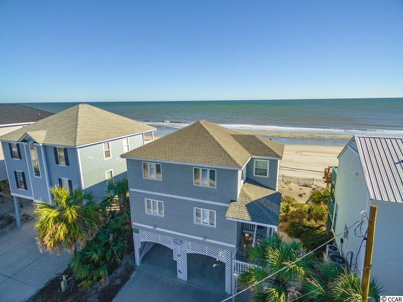 "LEAST EXPENSIVE OCEANFRONT HOME ON S. WACCAMAW DRIVE!   ""Ocean Pause"" offers 4 BR / 3 BA with large kitchen for family gatherings and vacations.  New HVAC units and kitchen refrigerator in 2018.  Large laundry room with extra refrigerator and utility sink.  Outdoor shower for rinsing off from a day on the beach.  Multi level decking on the rear of the home offers amazing views of the Atlantic and makes for easy access to the beach.  Home has excellent rental history."