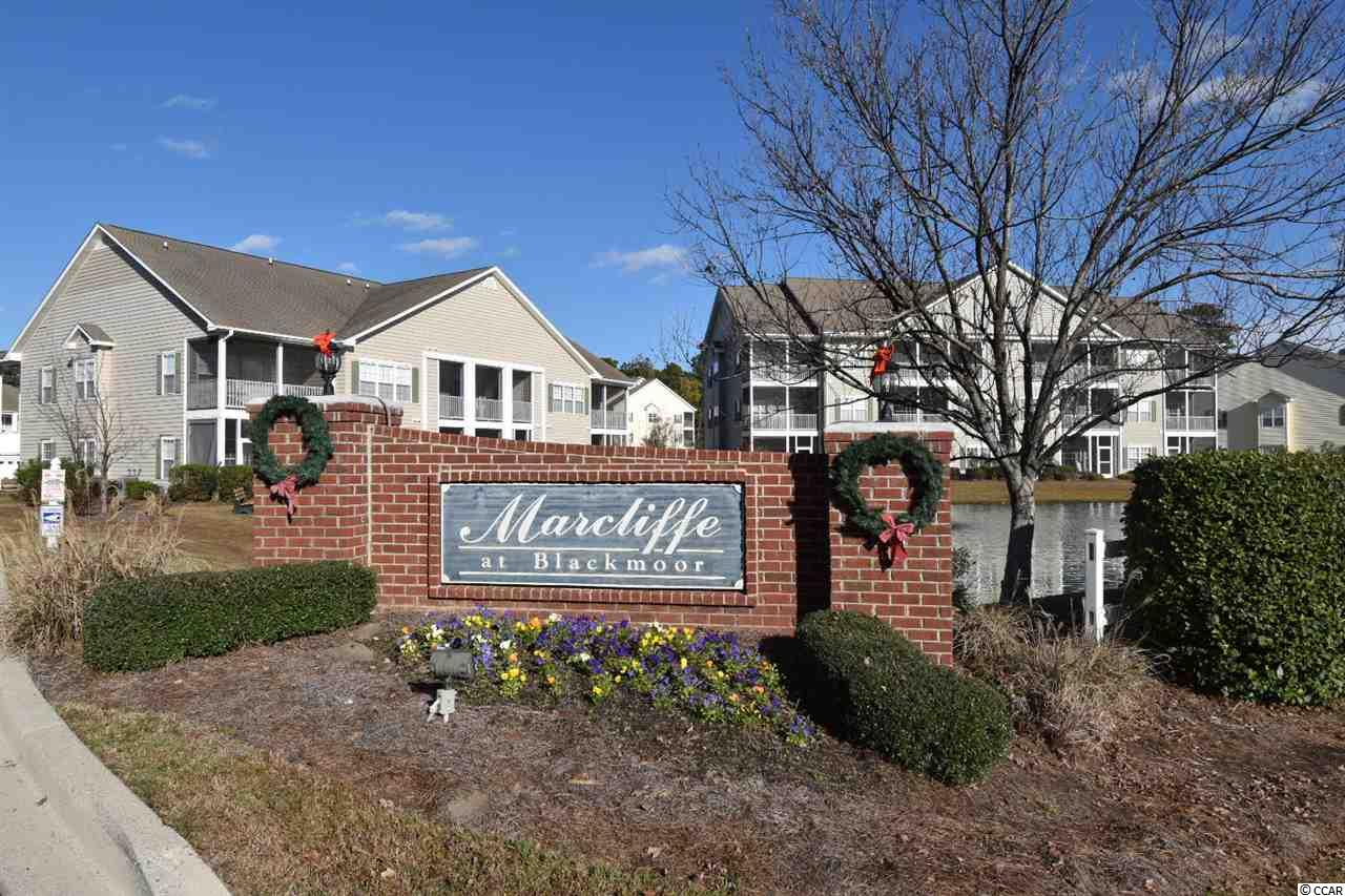 This top-floor end unit is located on the golf course in the Marcliffe condominium subdivision at Blackmoor. This modern and spacious condo hosts great views of the golf course from its large porch. Inside beautiful hardwood floors guide you into an open dining and living room with vaulted ceilings. The modern kitchen hosts abundant counter and cabinet space with a beautiful breakfast bar. The master suite features a walk-in closet and a dual-sink vanity for plenty of storage and counter space. With two additional bedrooms and one bath,the condo is perfectly compatible for families and those needing more space. This unit is essentially a large home that provides you all the benefits of being a condo.