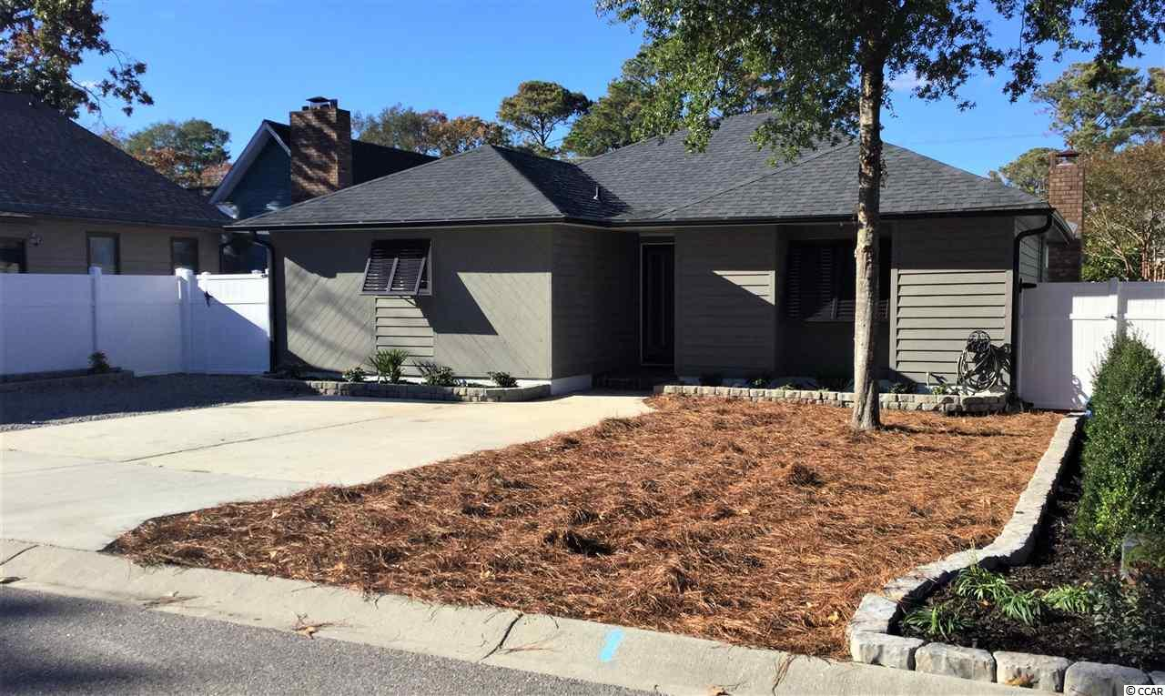 This is a rare find in Arcadian Shores! Walking or golf cart distance to the Ocean, restaurants, stores, golf and local Beach Taverns. This 3 bedroom 2 full bath has been completely renovated and updated and is a gem in this established tree lined community. The home has an open floor plan with lots of room and closet space. The lot is fenced with a lockable gate and secure golf cart parking and outside storage room. Come make this your home or would make a great investment vacation home.