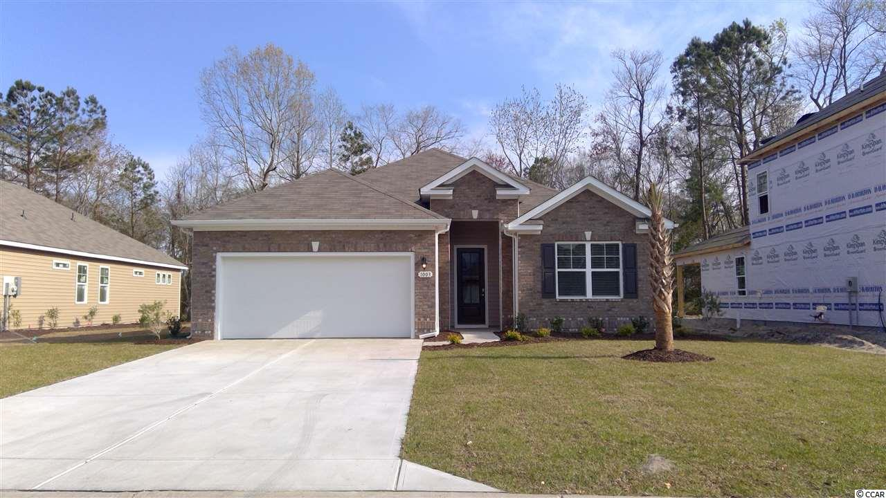 "Come out to see why everyone is deciding Waters Edge is the community to live in! Easy living at its best! This beautiful Eaton plan is nestled on a wooded lot! Come see this low maintenance, gated neighborhood! Mature trees and beautiful inlet view at Water's Edge! This home has 3 bedrooms, 2 baths, with a 2 car garage! Open concept floor plan! Kitchen features granite countertops, recessed and pendant lighting, and Frigidaire Gallery stainless steel appliances. Daltile Emblem porcelain hardwood look tile flooring in foyer, dining, living, and kitchen. Carpet in bedrooms and Daltile tile floors in baths and laundry. 5 1/4"" Base Boards & Crown Molding in the main living areas. Fully sodded lawn with irrigation. Lawn Maintenance is included in the HOA."