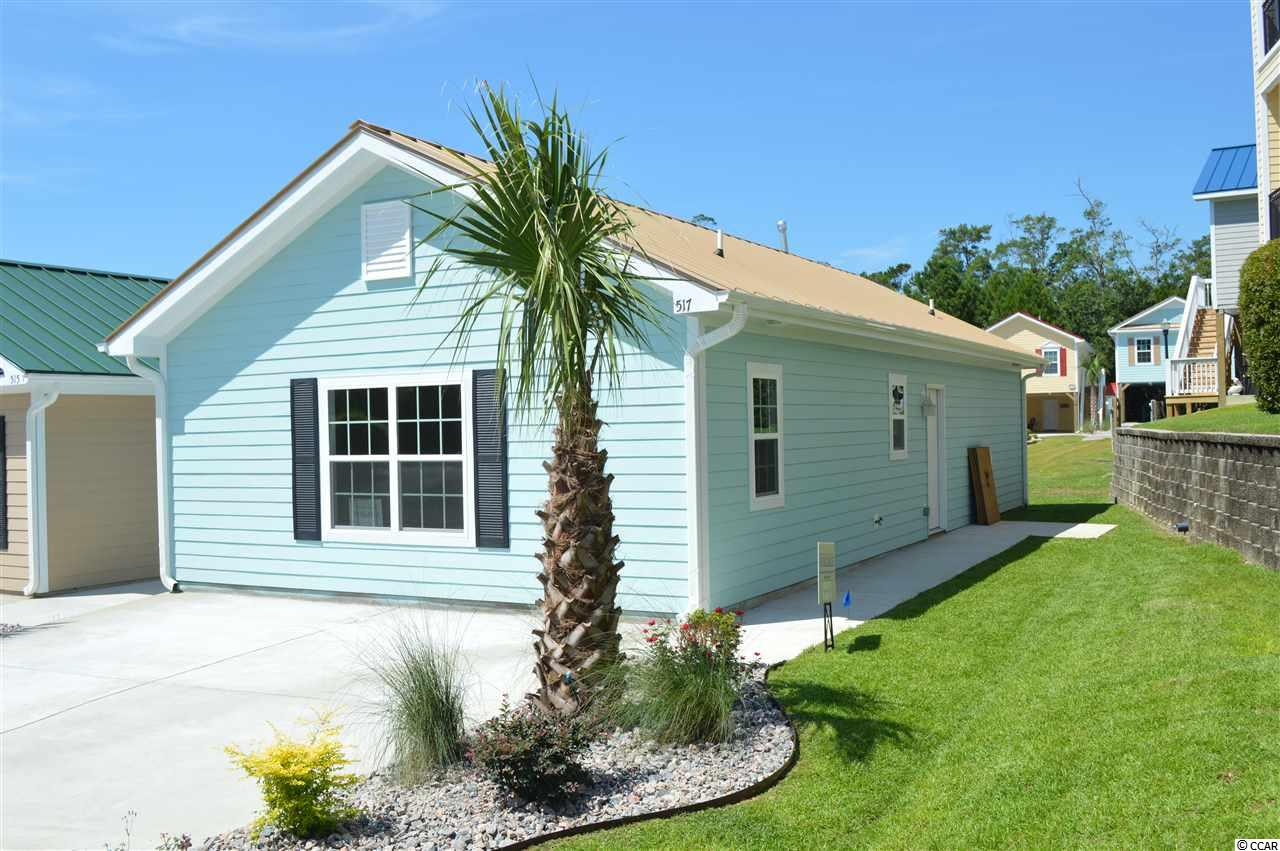This community has its own dry stack marina and offers discounted marina services to Grande Harbour homeowners! This brand new 2 bed/2 bath ground cottage is move-in ready and just 5 minutes from the beach in a natural gas community! Features include open floor plan, well appointed kitchen with center island, granite, gray shaker style cabinets with soft close doors & drawers, and stainless steel appliances. This home sits on a corner lot in a cul de sac and offers lots of natural night throughout. Exterior features include hardie plank siding, metal roof, and tankless hot water heater. All of these features are standard items at Grande Harbour so no long price list of upgrade costs here. Your dream of owning a new home close to the beach in a quiet community for a great price just came true! The landscaping, yard maintenance, irrigation, pool, covered picnic area with gas grill, even basic cable, internet, telephone, and security system with basic monitoring is all included in your HOA dues!