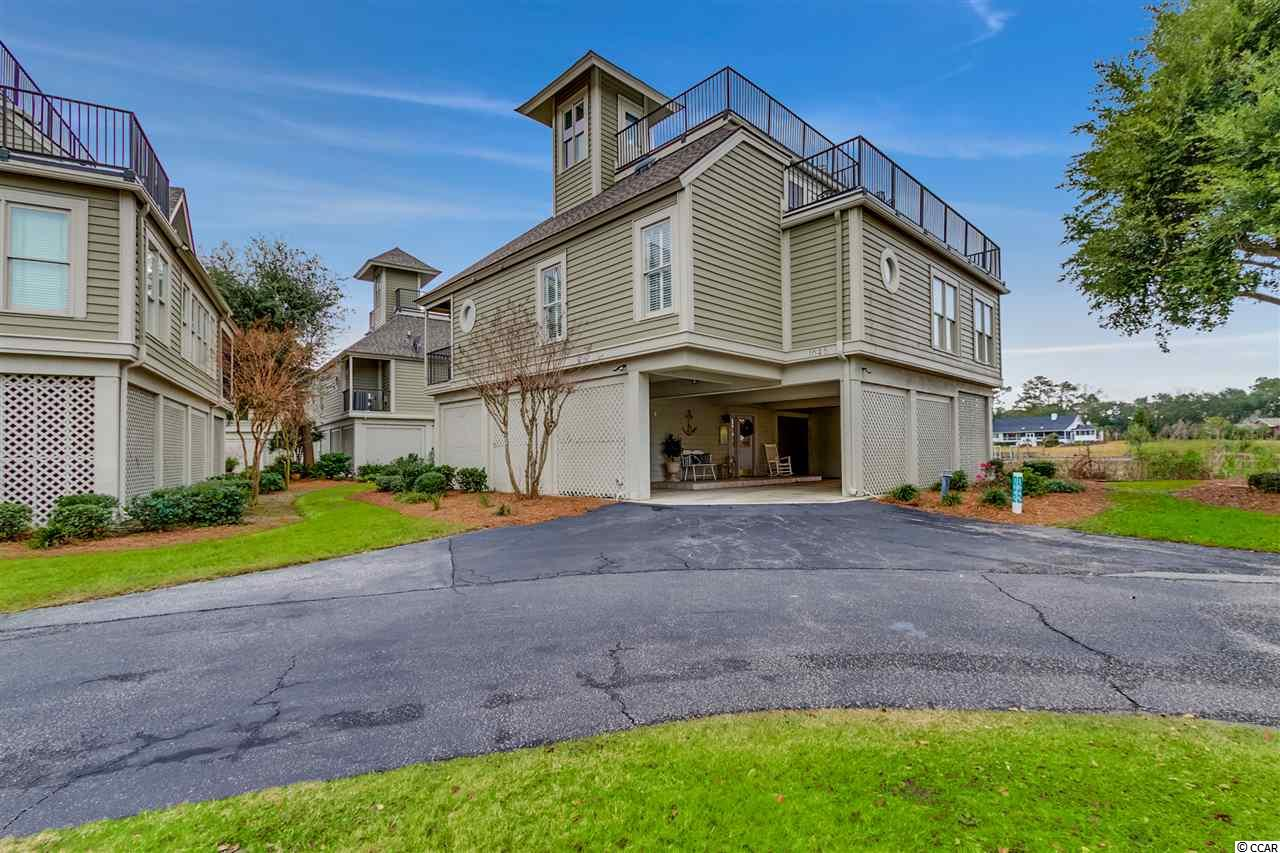 This magnificent home has its semi-private pier ready to have a boat lift installed if you desire, located directly on the Intracoastal Waterway. The breathtaking, panoramic views of the waterway can be seen from the master bedroom, family room, kitchen, VIP upstairs suite, porches, and roof top deck. HOA takes care of all yard maintenance, so you can just relax and enjoy your home and its spectacular surroundings. Located in beautiful Tidewater Plantation, a fully gated community with 24 hour manned security, you will have access to pools, tennis courts, beach cabana, state of the art fitness and amenity center. An 18,000 sf clubhouse with an award winning highly acclaimed golf course is also right there for your enjoyment.   WATERFRONT MASTERPIECE: This stunning Tidewater waterfront home is located near the Little River Inlet's ocean access. A wall of windows directly overlooks magnificent views of the ICW stretching forever in both directions. Observe passing boats, dolphins, pelicans, and natural surroundings from the rooftop deck, the screened side porch, or the ground floor open porch. This is the perfect home for a boater, only a short ride from your dock to the sparkling Atlantic Ocean. On the way in, you may want to stop at one of the local water sports, fishing, diving, sailing, paddle boarding spots, or a nature park that is available within a short distance. Nearby Myrtle Beach and the Grand Strand offer great restaurants, live performances, theater, amusement parks, gardens, and night life for all ages.   The Harbor Loft community dock is just 3 houses away – your boating friends can dock here and visit for the day. Opportunities are endless living in this area – it's a wonderful place for your friends to visit and an even more wonderful place to live!  All square footage is approximate, buyer will need to verify.   Closed in bottom makes great dry storage,( Cant get enough Storage) Day area, Gym area, and or Man/She cave.  Lots of potential.