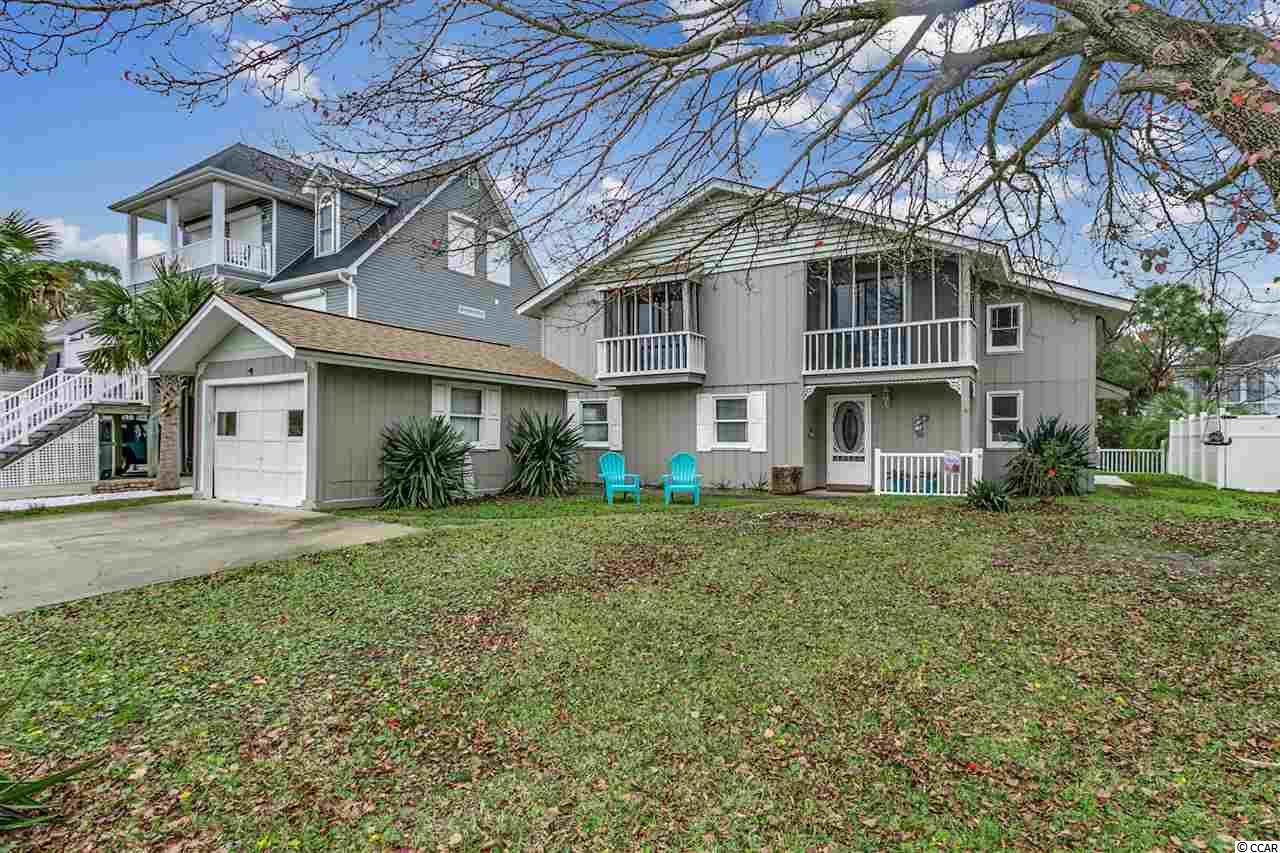 "What's NOT to love about your beach home at 608 25th Avenue South in North Myrtle Beach, SC ??!! This charming custom home is filled with a ton of character along with today's modern upgrades. You don't find homes like this anymore. You can actually ""feel"" this home's character and personality as soon as you enter the front door. This is NOT your cookie-cutter new construction with tiny rooms and no ""oomph"". 608 25th Avenue South is an ideal primary residence or 2nd home that is ONLY 4 short blocks from the OCEAN. There is NO HOA here, either. The home has tons of upgrades including a freshly painted interior AND exterior, and all within the last 1-3 years: New dishwasher; stove; sink faucets and valves; counter tops; all new flooring; and a new rear porch/pergola. As soon as you enter the foyer, the seashell-accented staircase to your right will instantly make you feel like you're finally here at the Beach. The living room will greet you as you leave the foyer and features double-story high ceilings, a ceiling fan, a fireplace on a white-brick accent wall, and a relaxing view of the lake out back. The kitchen and breakfast bar are next to the formal dining room and both have views of the lake as well. The kitchen features a large farm sink, smooth-top range, dishwasher, refrigerator, ceiling fan, tiled back-splash, and a white-brick accent wall. The dining room has a ceiling fan, crown molding, and a sliding glass door to the backyard. Downstairs you'll see the 2 guest bedrooms along with a full bathroom that has a tub/shower combo, framed mirror, decorative lighting, and crown molding. There are elongated tiled floors downstairs in the foyer, living room, dining room, and both guest bedrooms. There are also 2 decorative tile in-lays in the foyer and kitchen area. Upstairs is very cool: At the top of the stairs, to your right is a small niche that would make a great little computer/work area, or child's play area, or pet napping spot. The rest of the upstairs is one HUGE MASTER SUITE with a large master bedroom with a large double closet, 2 ceiling fans, and sliding glass doors to the 2nd floor reared screened porch overlooking the lake. There is also a huge living area that could be anything you want: A media center; huge home office; or even convert it into 1 or 2 more bedrooms, if needed. Upstairs there is what's called ""high moisture"" wood plank floors with moisture-proof padding. And there are tile floors below this floating wood floor so feel free to keep it as it is, or remove the floating wood floor if you'd prefer tile upstairs. In addition to all of this, there is a HUGE 1st floor rear screened porch overlooking the lake, a HUGE 2nd floor rear porch (half-screened in, half open-air sundeck), a small 2nd floor front porch, and side and rear fencing (just add 2 gates - 1 on each side of the house - and you'll have a completely fenced-in back yard). There's also a transferable termite bond already in place, the HVAC system is serviced regularly, you have a 1-car garage, and you can bring your golf cart as well !! The owners have already moved out so your new beach house is ready and waiting for you. Priced to sell and, again, ONLY 4 blocks to the ocean and centrally located right in North Myrtle Beach, SC."