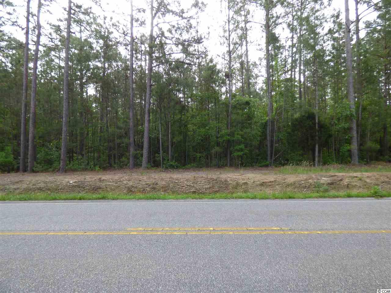 """Looking for space...this is it! Come and build your dream home, spread out and enjoy this ideal """"estate sized lot"""" in Little River, a wonderful wooded large lot. No HOA, stick built homes only. Quiet and secluded and yet right in the heart of everything! Easy access to Little River and Calabash, boating and golf course communities surround this little gem and only 15 minutes to the beach and all the beach activities. 300 feet of road front access."""