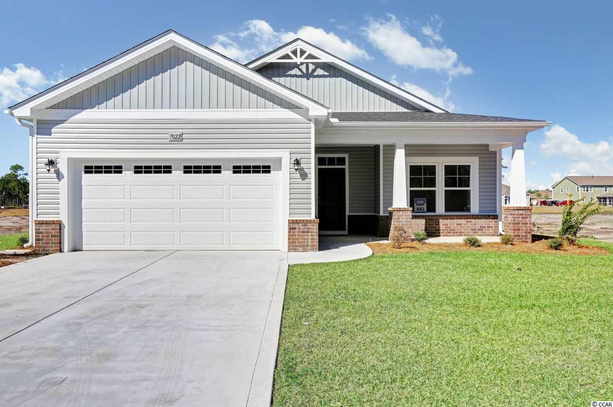 "**HUGE PRICE REDUCTION** PLUS CRAZY 8 INCENTIVE FOR LIMITED NUMBER OF INVENTORY CONTRACTS ACT FAST!  ASK AGENT FOR DETAILS! The Aurora Plan.  Now available at Clear Pond at Myrtle Beach National. This natural gas neighborhood will feature our most popular home plans and all home sites backing to the privacy and serenity of woods, wetlands and ponds.  The Aurora is a 2 bedroom 2 bath home with open living space, large kitchen island over looking your great room. great room, kitchen, and dining room.   This home is located on the pond. A bay window in the dining room and master bedroom has been added along with 5"" laminate flooring in the foyer, great room, kitchen and dining area. Tile in all wet areas. The master has a 5' walk in tiled shower. SST single bowl kitchen sink, with upgraded faucet. A gas range has been added. Additional can lights. Glass in the garage door with hinges. Upgraded granite in the kitchen, upgraded gray cabinets whole house. Upgraded brushed nickel finishes.   Best of all, this home was built with our ecoSelect energy program. This means this home has been built with 2X6 exterior walls which allows for added strength and straighter walls. This allow for better insulation of a R19 value. Also included is a radiant barrier in the roof line. Low E windows, energy efficient lighting, 16 seer HVAC unit. Gas heat, gas water heater. All certified by a third party quality inspection.  There are plenty of standard options that your H&H home will feature. Some of these are a front porch,  12"" ceramic tile floors in the wet areas of the home. 5"" Bourbon Mill laminate in the foyer kitchen/nook and  dining(per plan)  Carpet in all bedrooms. Cabinets are 36""/42"" staggered with crown molding. Granite in the kitchen along with Stainless steel appliances. Your master bath will come with double sinks, garden tub and walk in shower.  This home comes with full landscaping, irrigation. and gutters on the entire home. So many features to list. Contact the listing agent for all the details.  We also have a full state of the art design center to choose many luxury options and customize your new home.   Call your sales representative for more information on this program.  Pictures shown are of actual home."