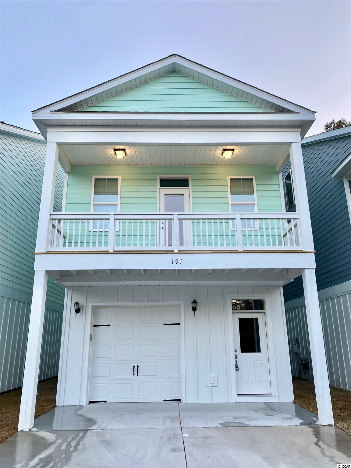 """BRAND NEW RAISED BEACH HOME To Be Built & Located 1 Mile From The Beach! Enjoy Easy Living At Jamestowne Landing, Which Has An HOA That Manages The Homeowners Insurance, Exterior Maintenance, Trash Pickup, Cable TV, Lawncare/Landscaping, Pest Control & Community Pool Which Is Only Steps Away. GOLF CART TO THE BEACH Straight Down Jamestown Rd/Atlantic Ave To Multiple Garden City Beach Access Points (1.25 Mile Route). Enjoy All The Garden City Beach Restaurants, Garden City Pier, Arcade & Shops. Restaurants & Shops Are Within Walking Distance Of Community As Well. The """"SANIBEL"""" Model Offers 3 Beds, 2 Full Baths, And Has A DEEP One-Car Attached Garage & 2 Car Parking Pad... PLUS... Shared Parking Throughout The Community. Plenty of Room In The Garage For Your Toys. The Inviting Front Covered Porch Has Overhang & (Optional) Paddle Fans...All You Need Is Your Glass of Iced Tea! Exterior Is Low-Maintenance Concrete Fiber Siding. Half Bath Can Be Added on Ground Level Behind Garage. Upgrades Available For Your Customization. Several Floor Plans With Ground Level Bonus Room & Extended Master Bedroom Are Available For This Site. Lot 403 Backs Up To Wooded Area. Ideal Primary Home or Beach Getaway! Pictures Are Of A Similar Existing Upgraded Model. Sq. Ft. Is Approximate And Not Guaranteed, Buyer To Verify."""