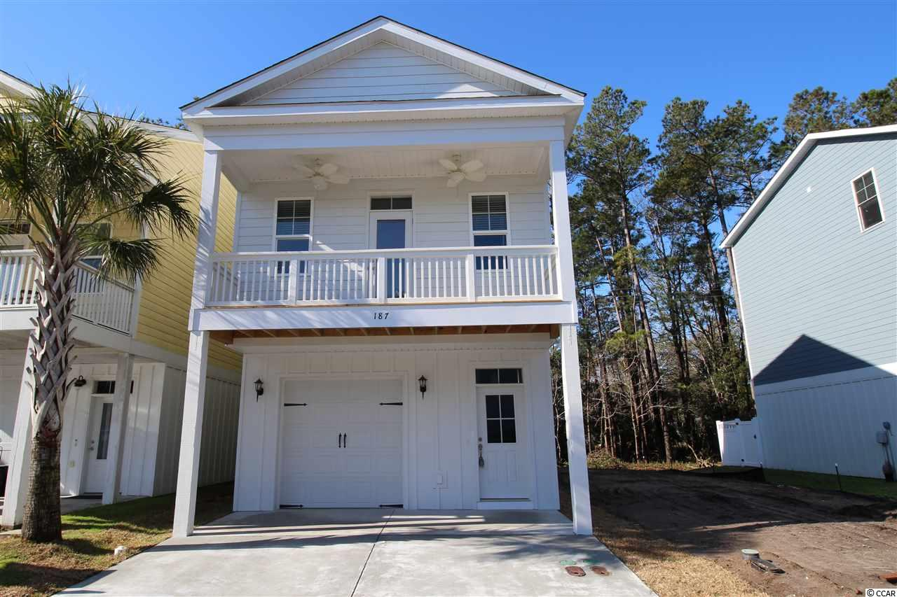 """BRAND NEW RAISED BEACH HOME To Be Built & Located 1 Mile From The Beach! Ideal Primary Home or Beach Getaway! Enjoy Easy Living At Jamestowne Landing, Which Has An HOA That Manages The Homeowners Insurance, Exterior Maintenance, Trash Pickup, Cable TV, Lawncare/Landscaping, Pest Control & Community Pool Which Is Only Steps Away. GOLF CART TO THE BEACH Straight Down Jamestown Rd/Atlantic Ave To Multiple Garden City Beach Access Points (1.25 Mile Route). Enjoy All The Garden City Beach Restaurants, Garden City Pier, Arcade & Shops. Restaurants & Shops Are Within Walking Distance Of Community As Well. The """"SEABREEZE"""" Model Offers 3 Bedrooms, 3 Full Baths, Over 1800+ Heated Sq. Ft... PLUS A Bonus Room with Full Bath On Ground Level, Which Would Make A Great Guest Room or Mother-In-Law Suite. Deep One-Car Attached Garage & 2 Car Parking Pad Plus Shared Parking Throughout Community. The Inviting Front Porch Has Overhang & (Optional) Paddle Fans...All You Need Is Your Glass of Iced Tea! Exterior Is Sturdy, Low-Maintenance Concrete Fiber Siding. Lot 402 Backs Up To Wooded Area. Several Other Floor Plans Are Available For This Site. Upgrades Available For Your Customization. Pictures Are Of A Similar Existing Upgraded Model. Sq. Ft. IsApproximate And Not Guaranteed, Buyer To Verify."""